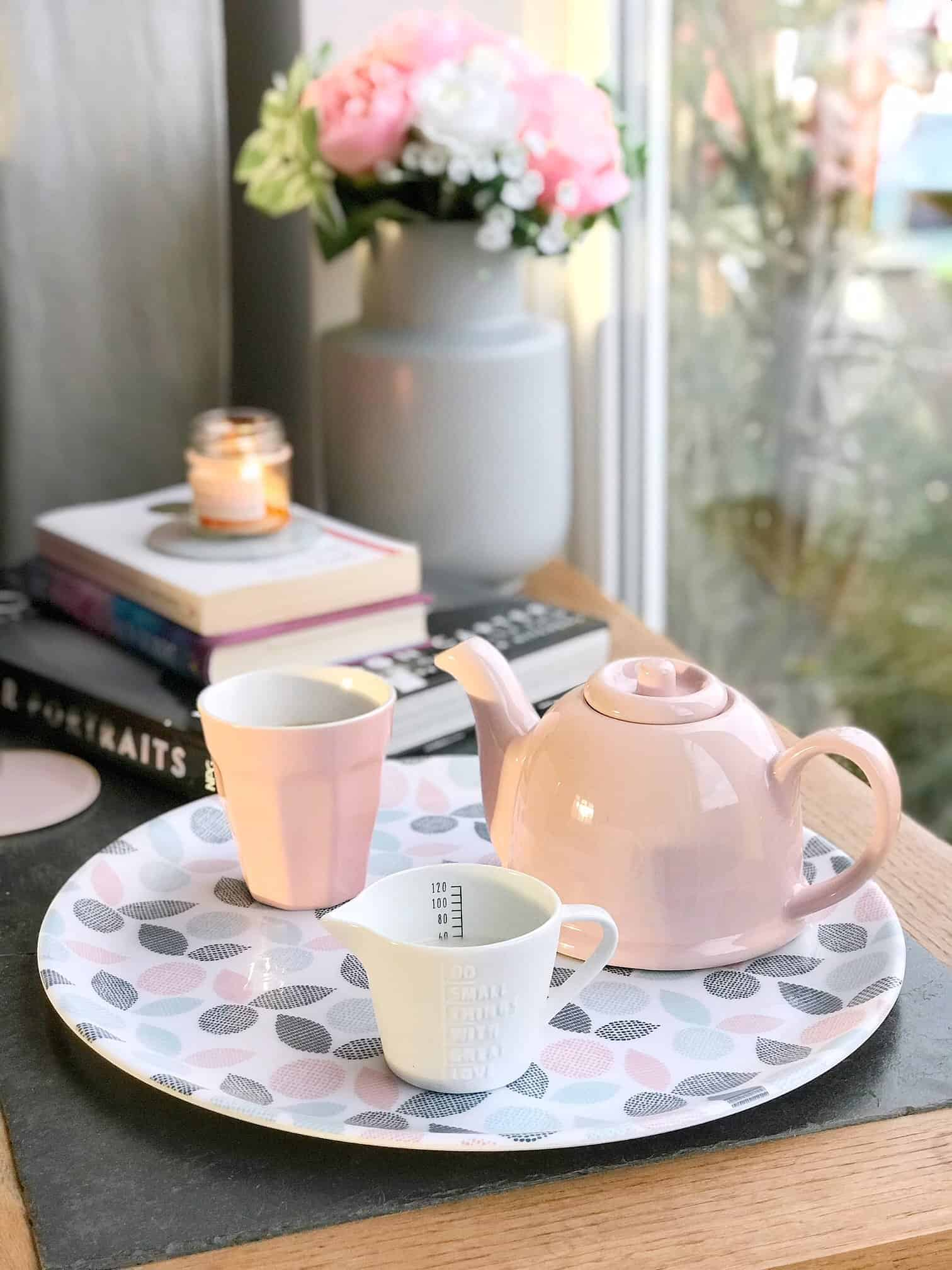 Pink teapot cup and jug next to our cosy reading nookPink teapot cup and jug next to our cosy reading nook