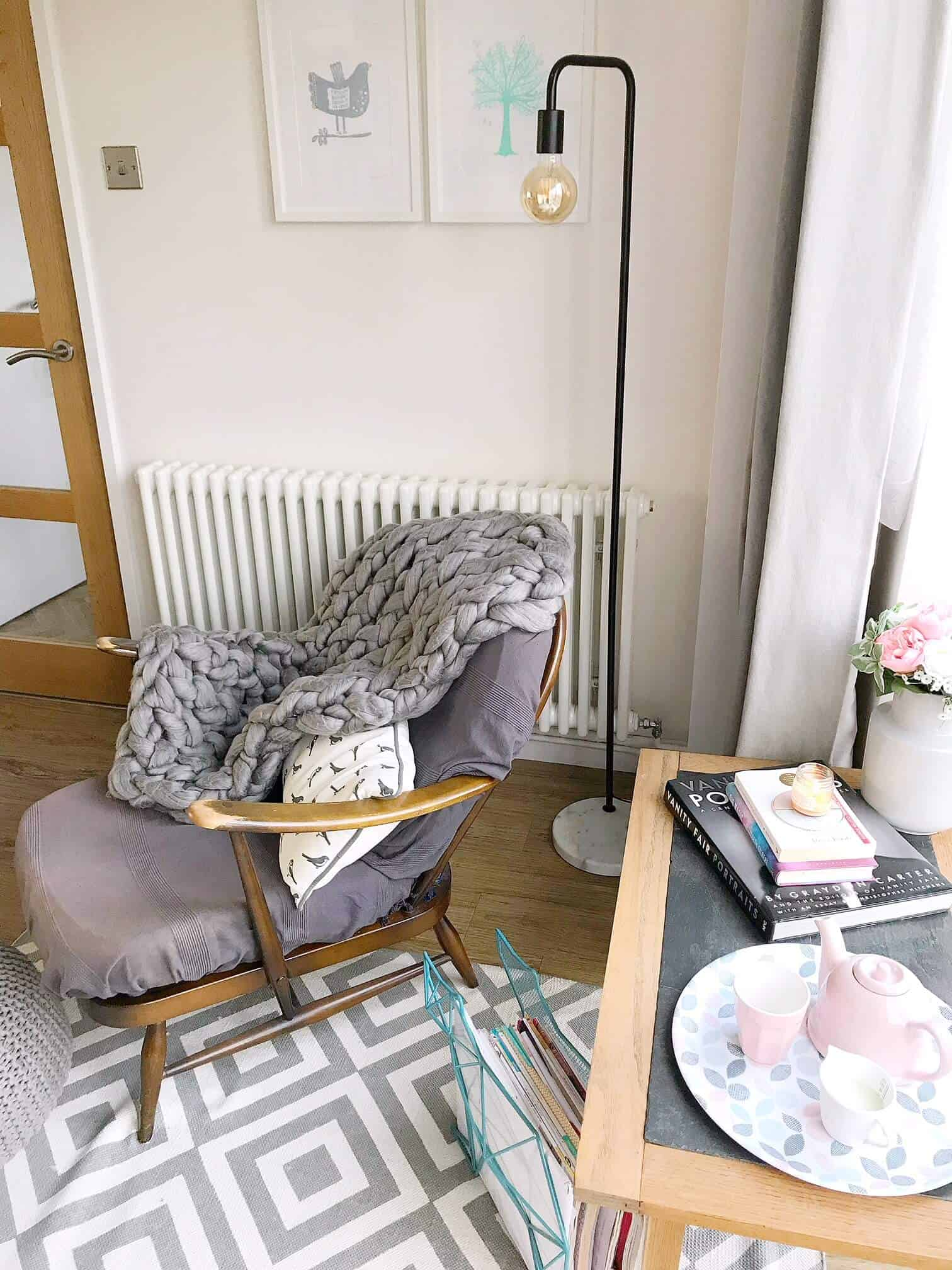Cosy reading nook next to a radiator