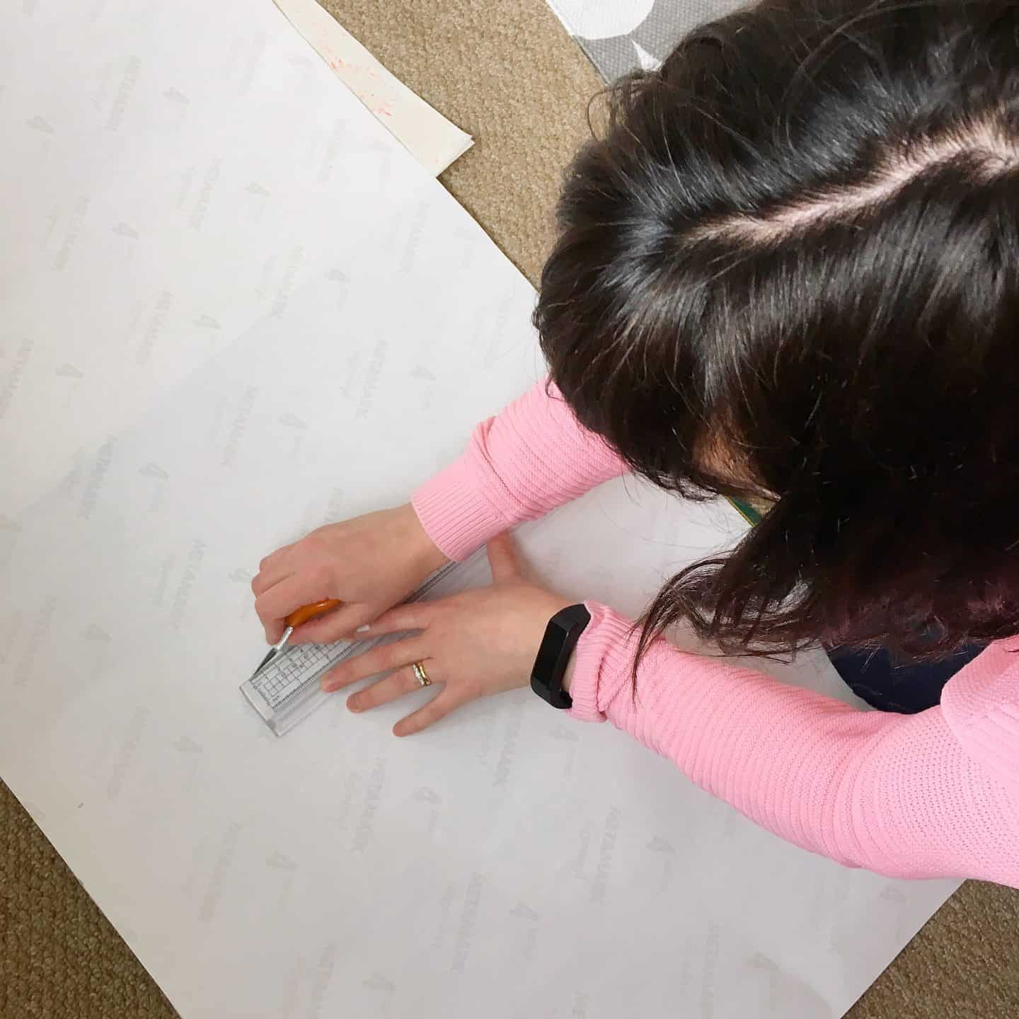 Cutting our Window Film with a craft knife for the perfect fit