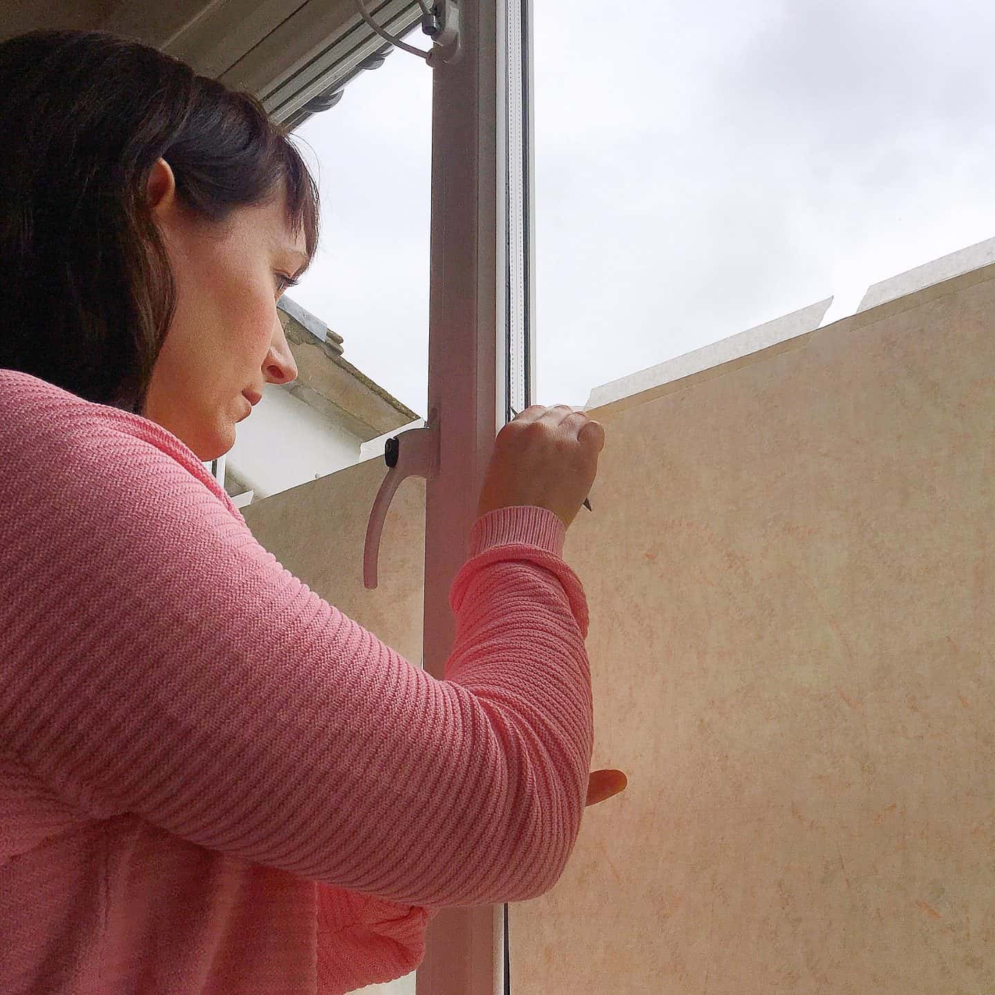 Smoothing over the window film with a squeegee