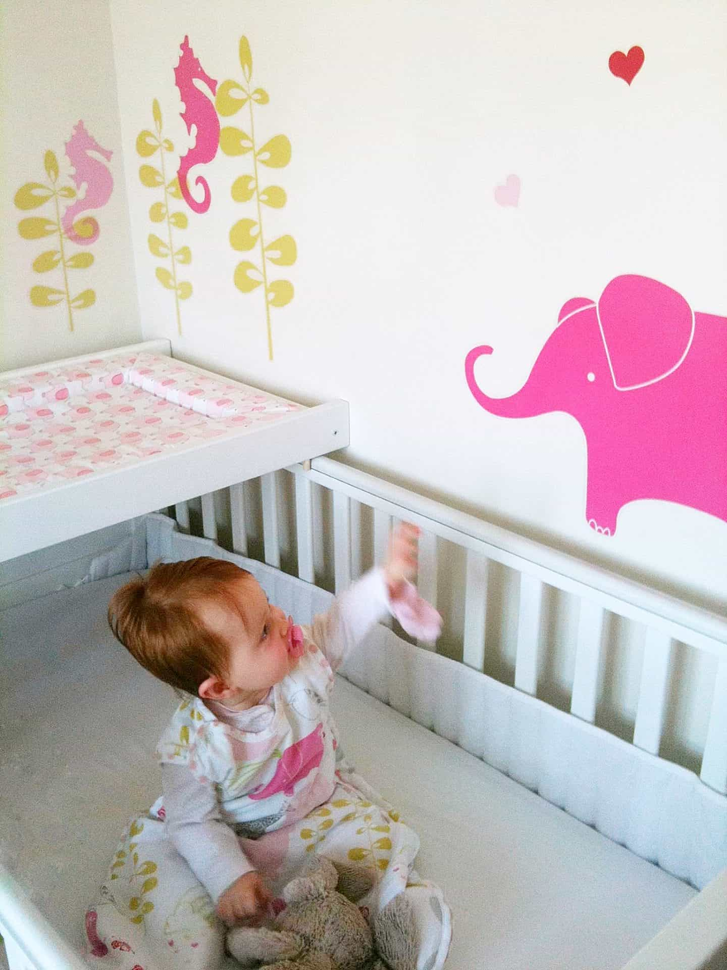 Ava's nursery decor with Mamas & Papas stickers and sleep pod