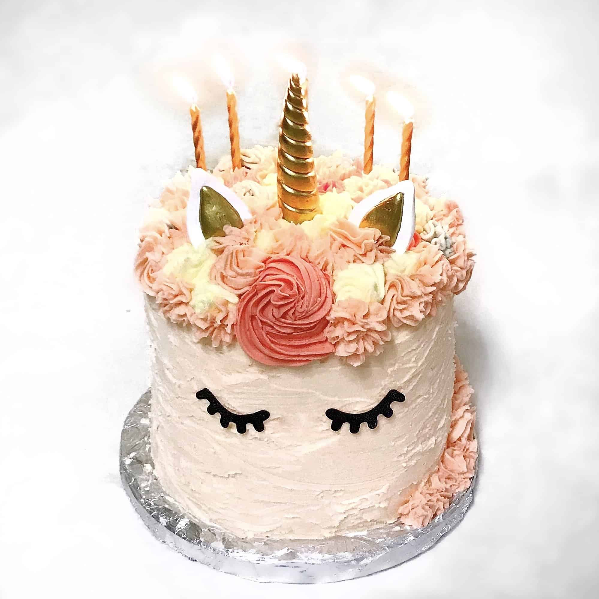 Rainbow Unicorn Cake with gold candles