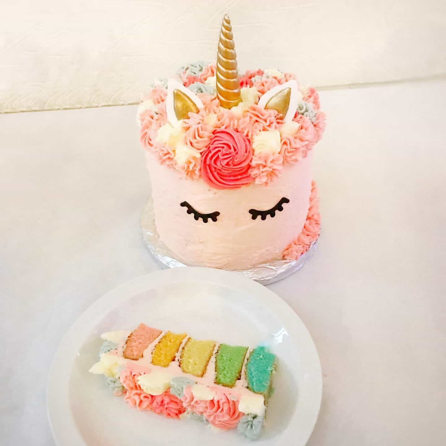 Rainbow unicorn cake sliced up