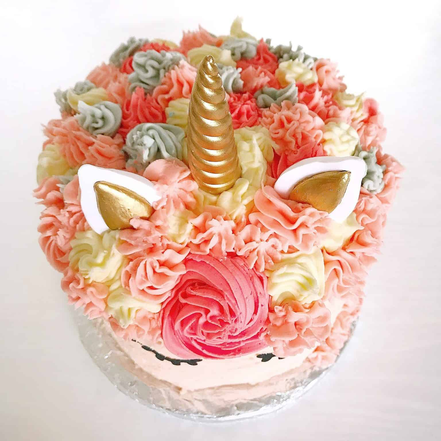 Top of a pink rainbow unicorn cake