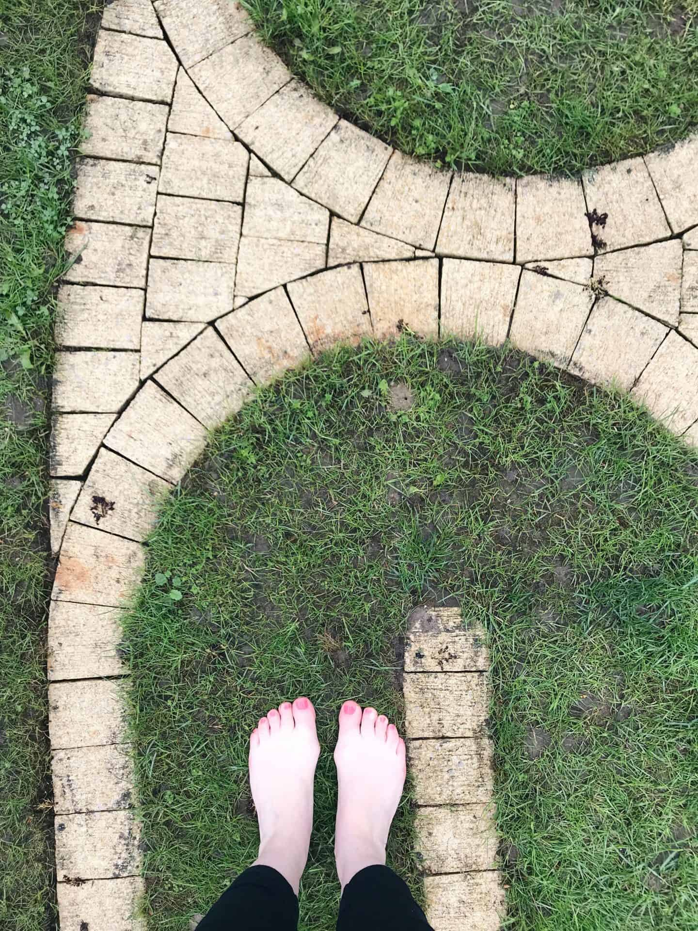 Walking bare foot on the labyrinth at Tofte Manor on the Mama Retreat