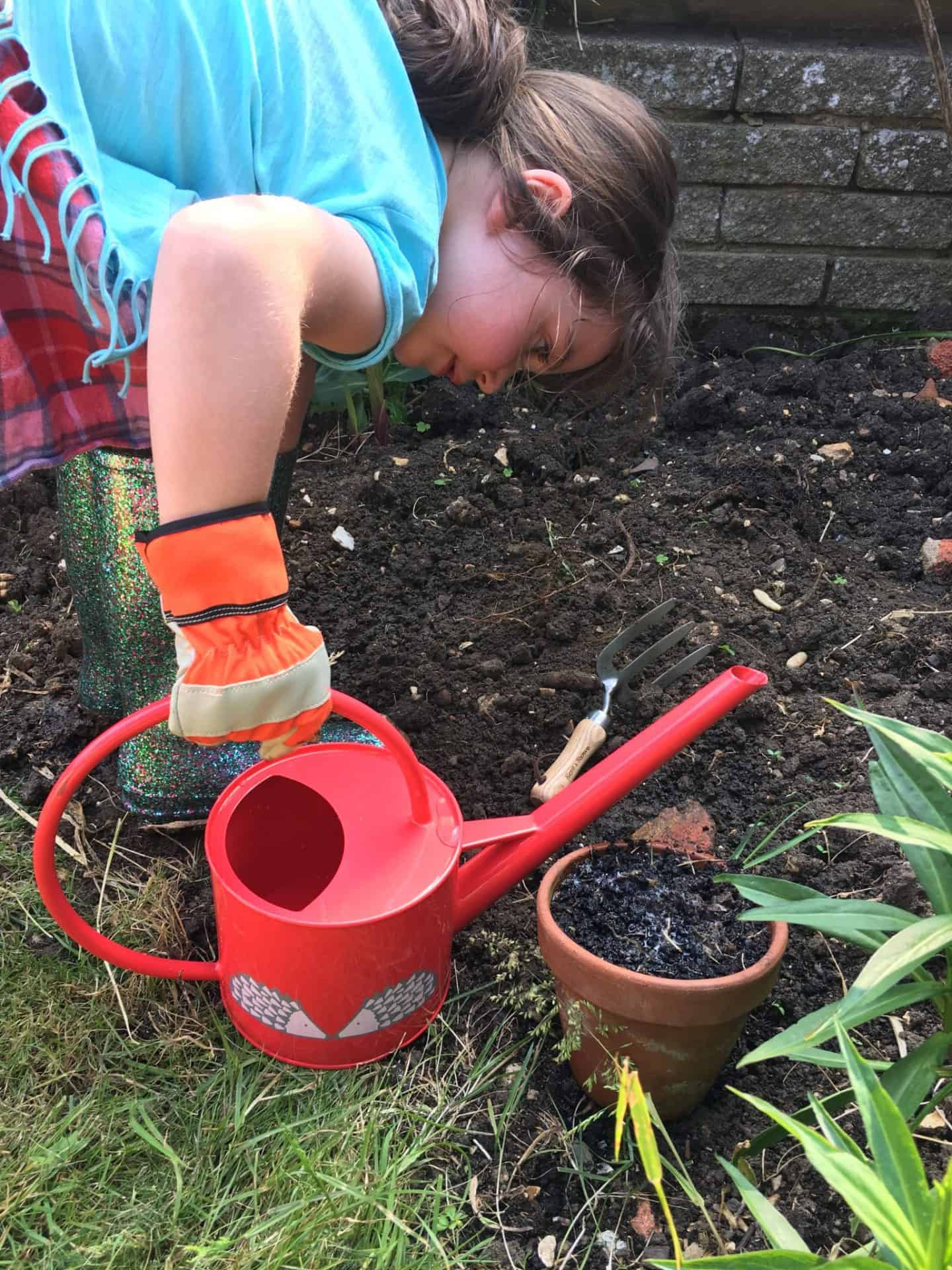 Watering plants for #GetThemGrowing for National Children's Gardening Week