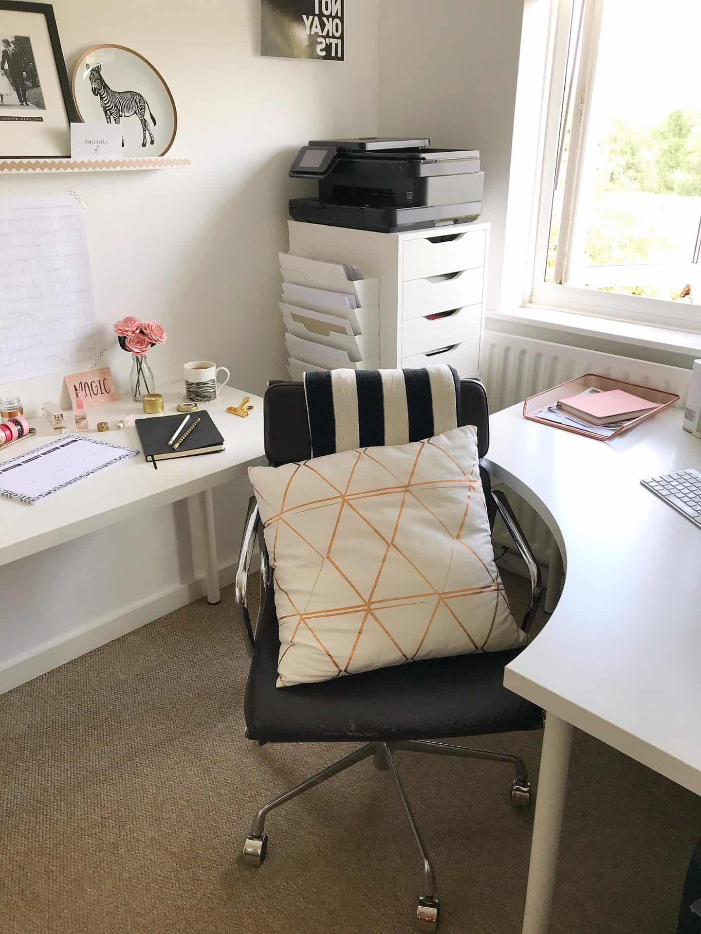 Desk chair with black and white blanket and white and copper cushion helps set up your home office for success