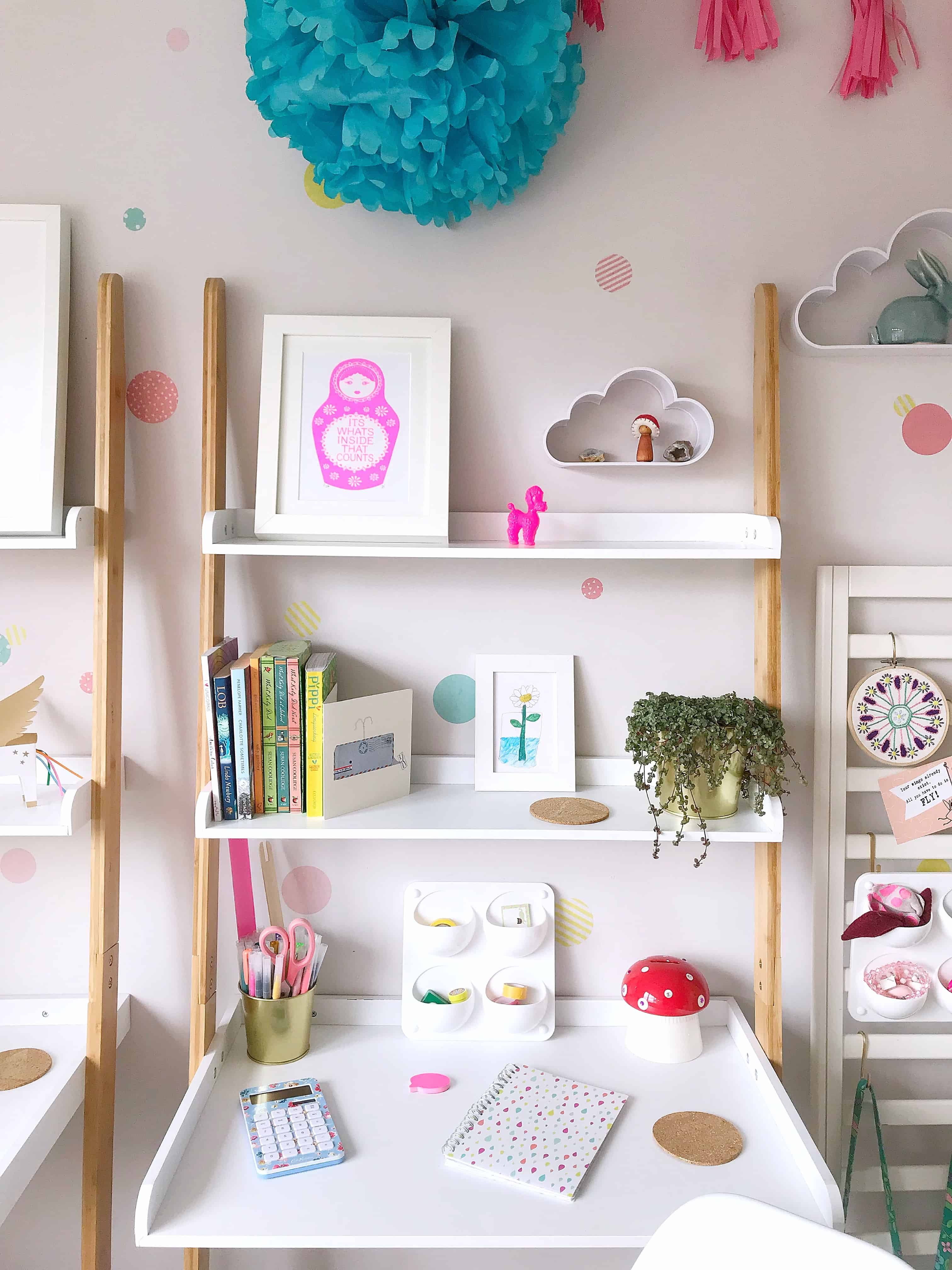 Ava's white and bamboo space-saving ladder desk from Futon Company with neon print and trailing plant