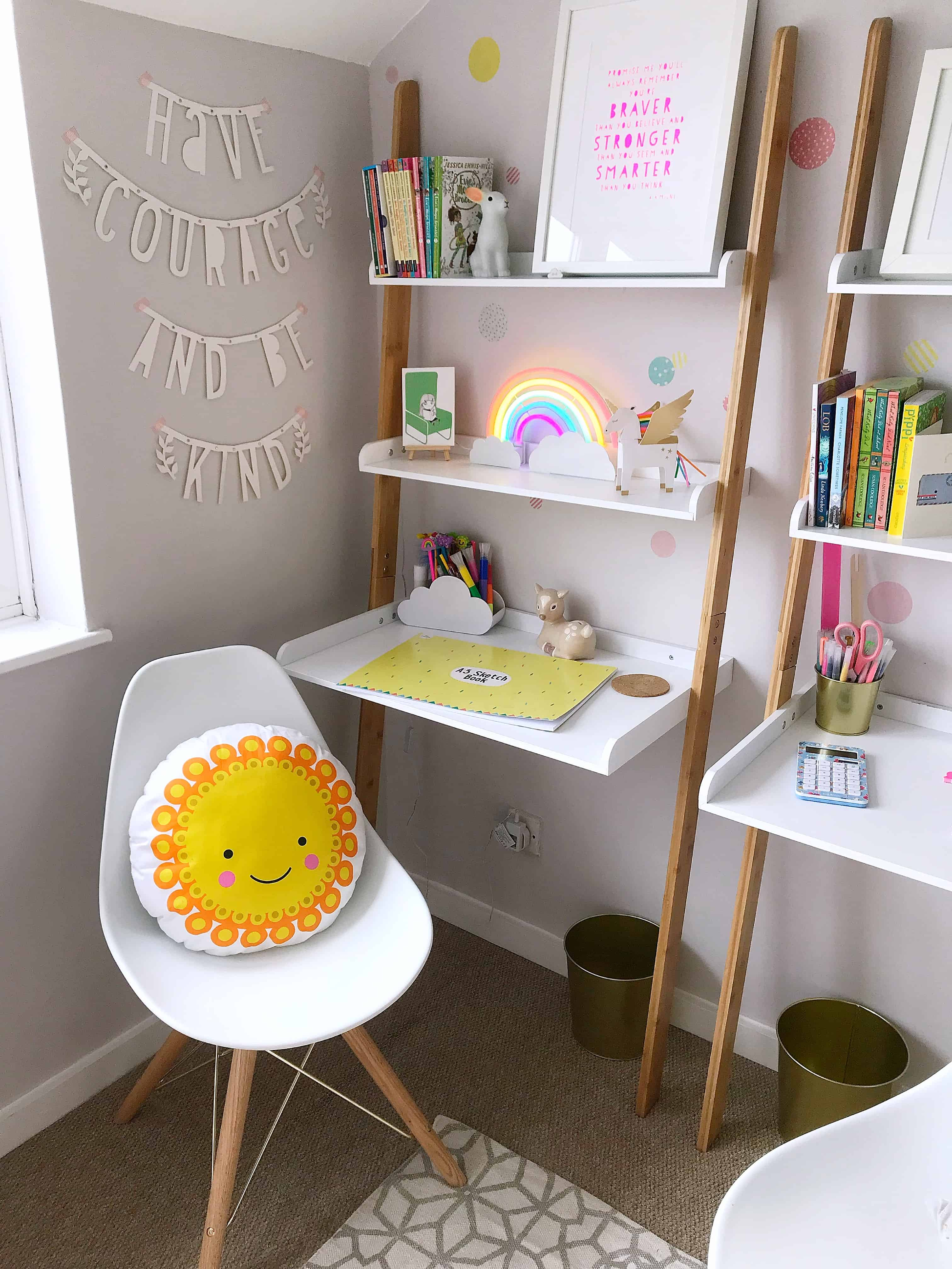 Corner of a child's room with Futon Company ladder desk and Cult Furniture white chair