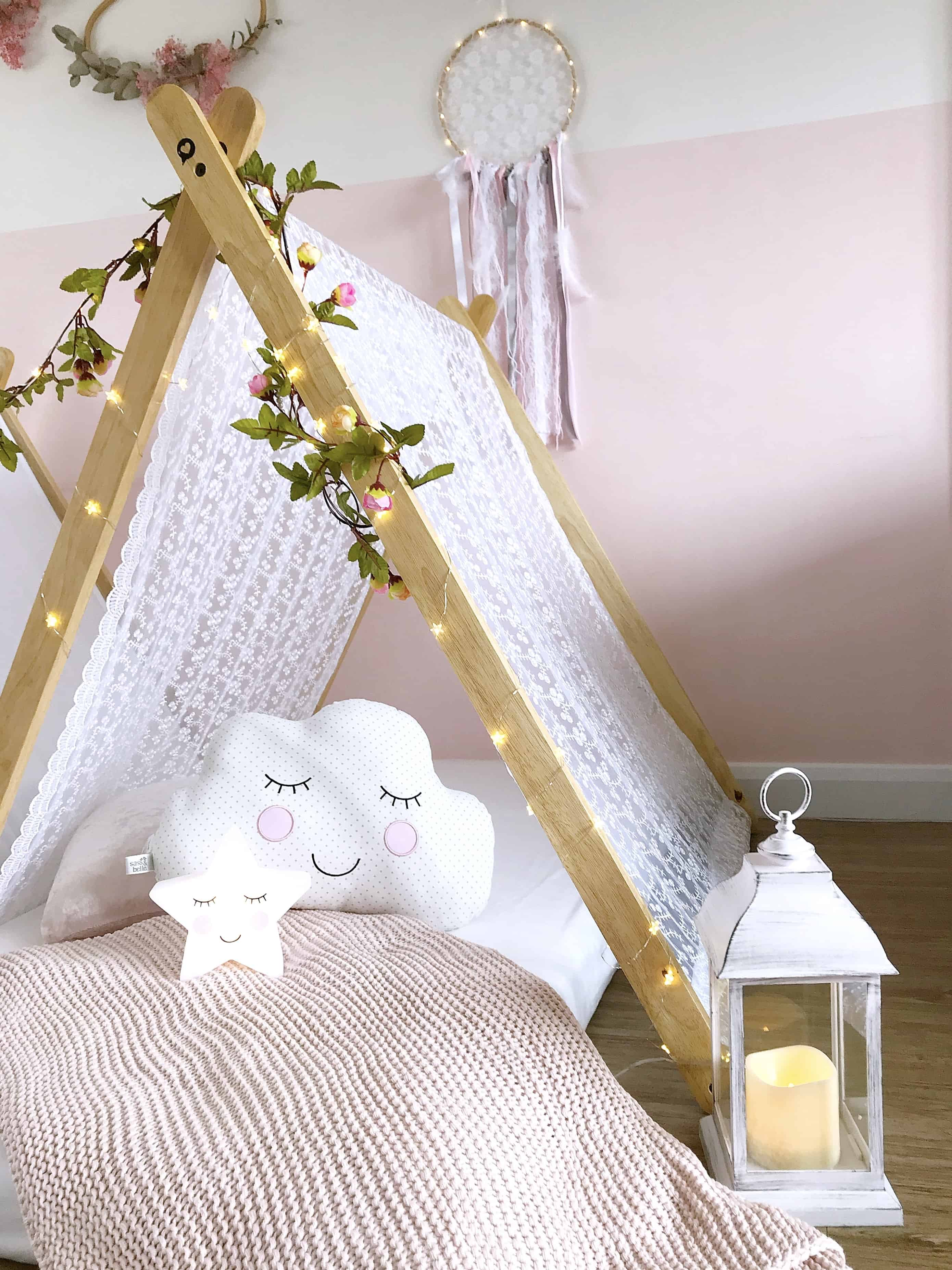Cosy white wood-framed tent at our kids tee pee party