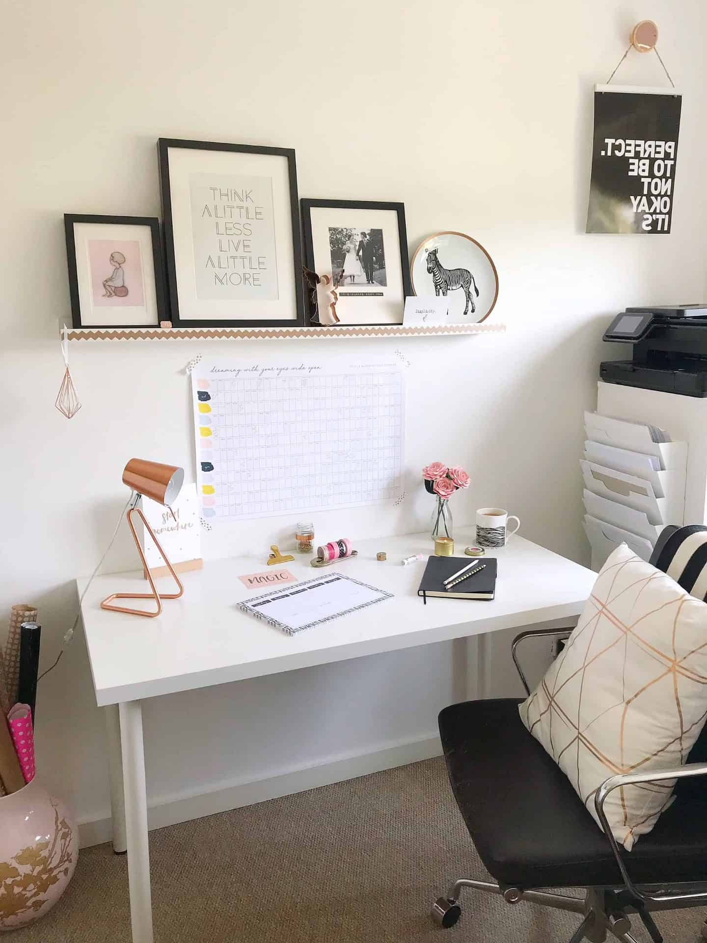 Monochrome home office with pink and copper accents