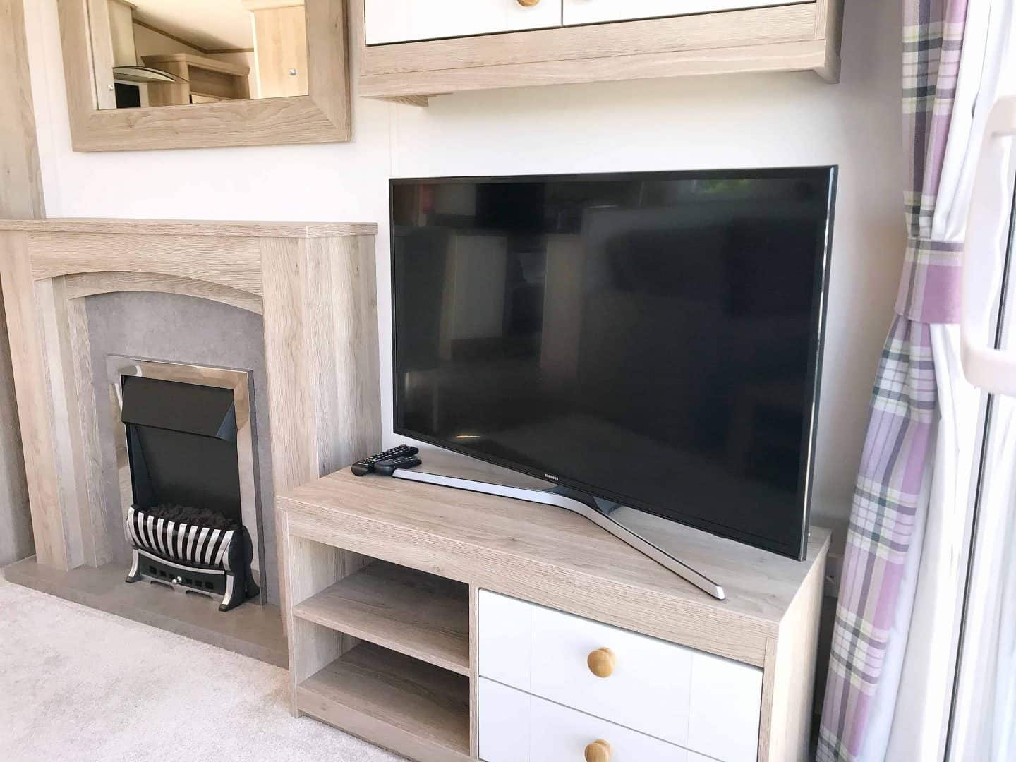 TV and fire at our static caravan at Trevornick, Newquay