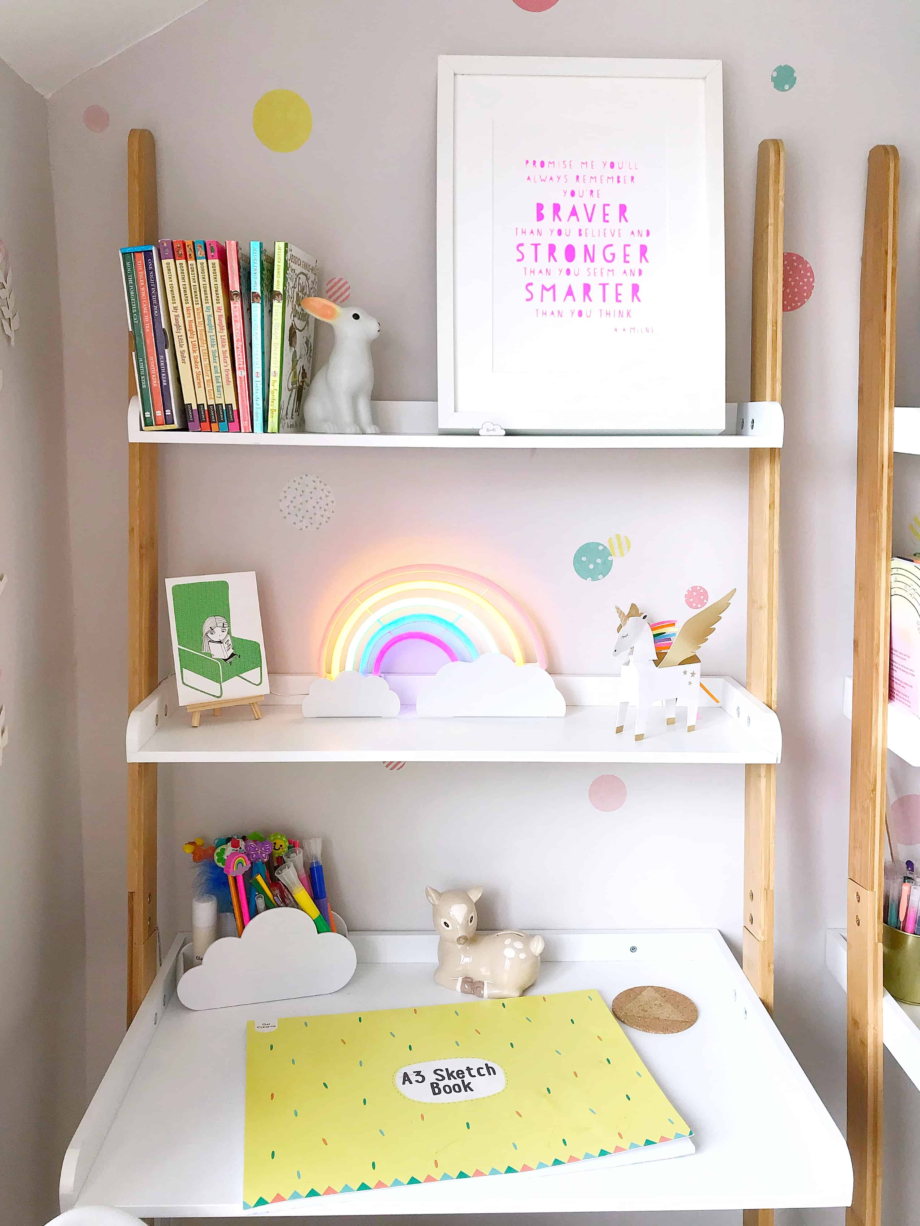 Thea's white and bamboo space-saving ladder desk from Futon Company with rainbow neon light and AA Milne print