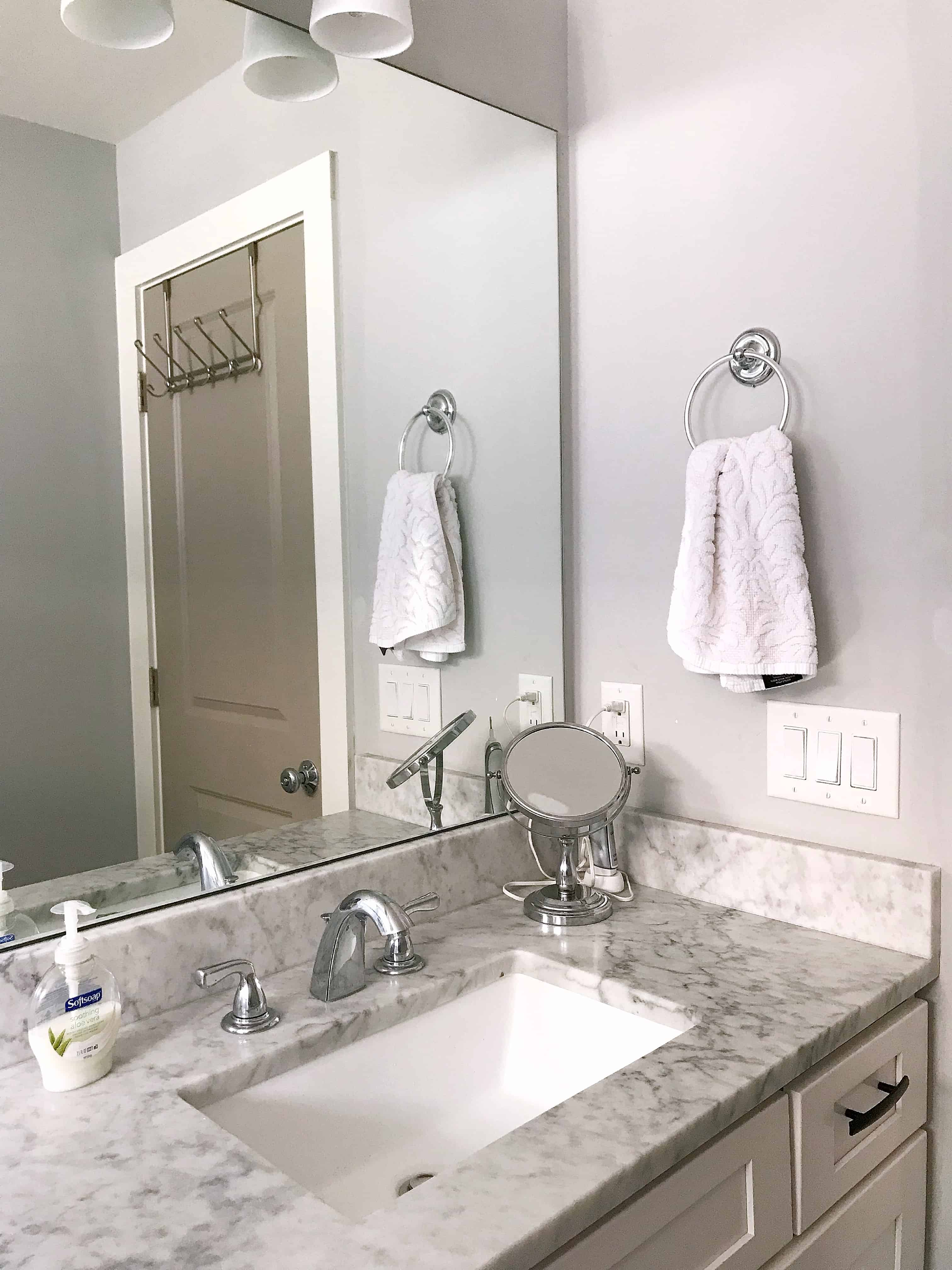 Bathroom with marble sink surround
