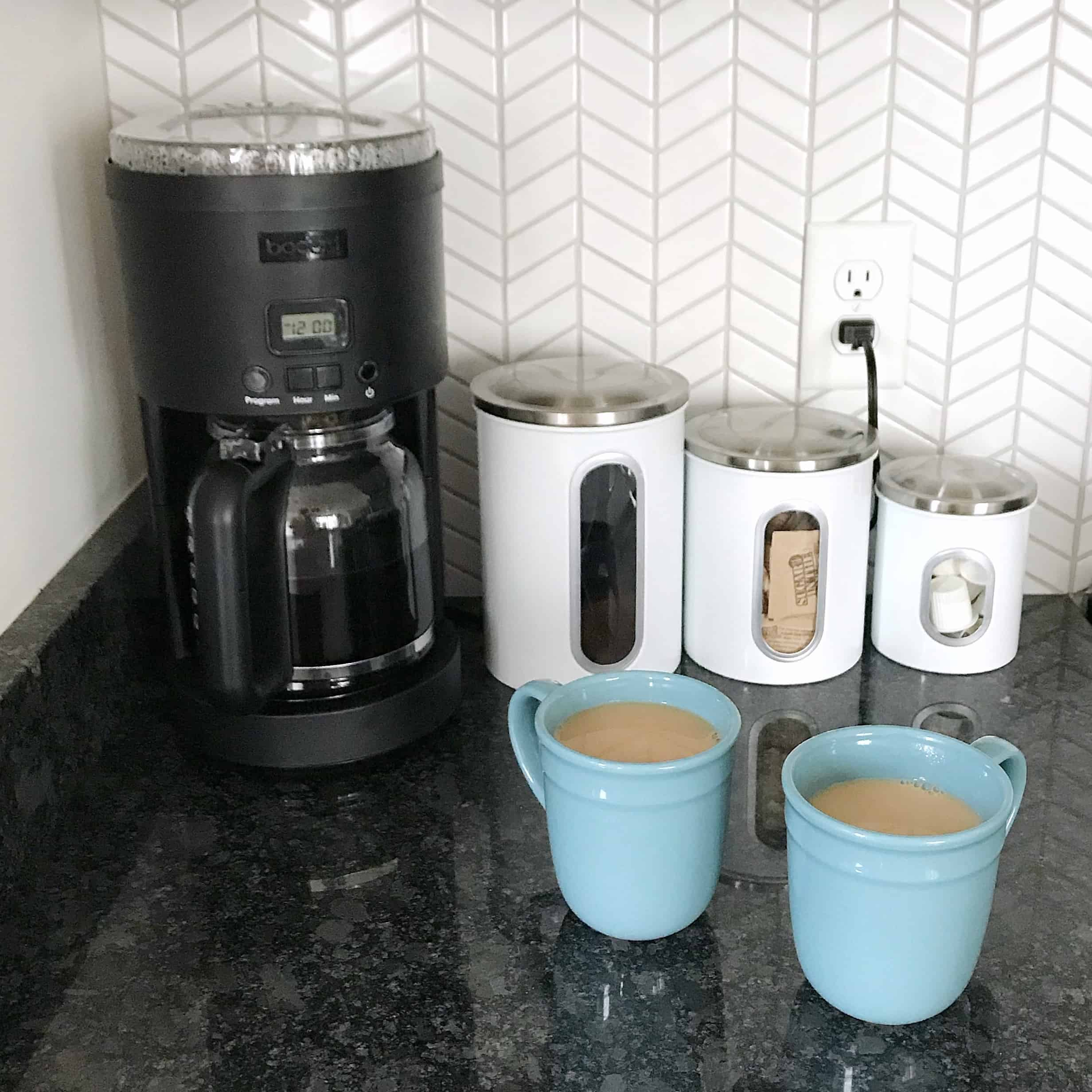 Coffee maker and cups in a monochrome kitchen