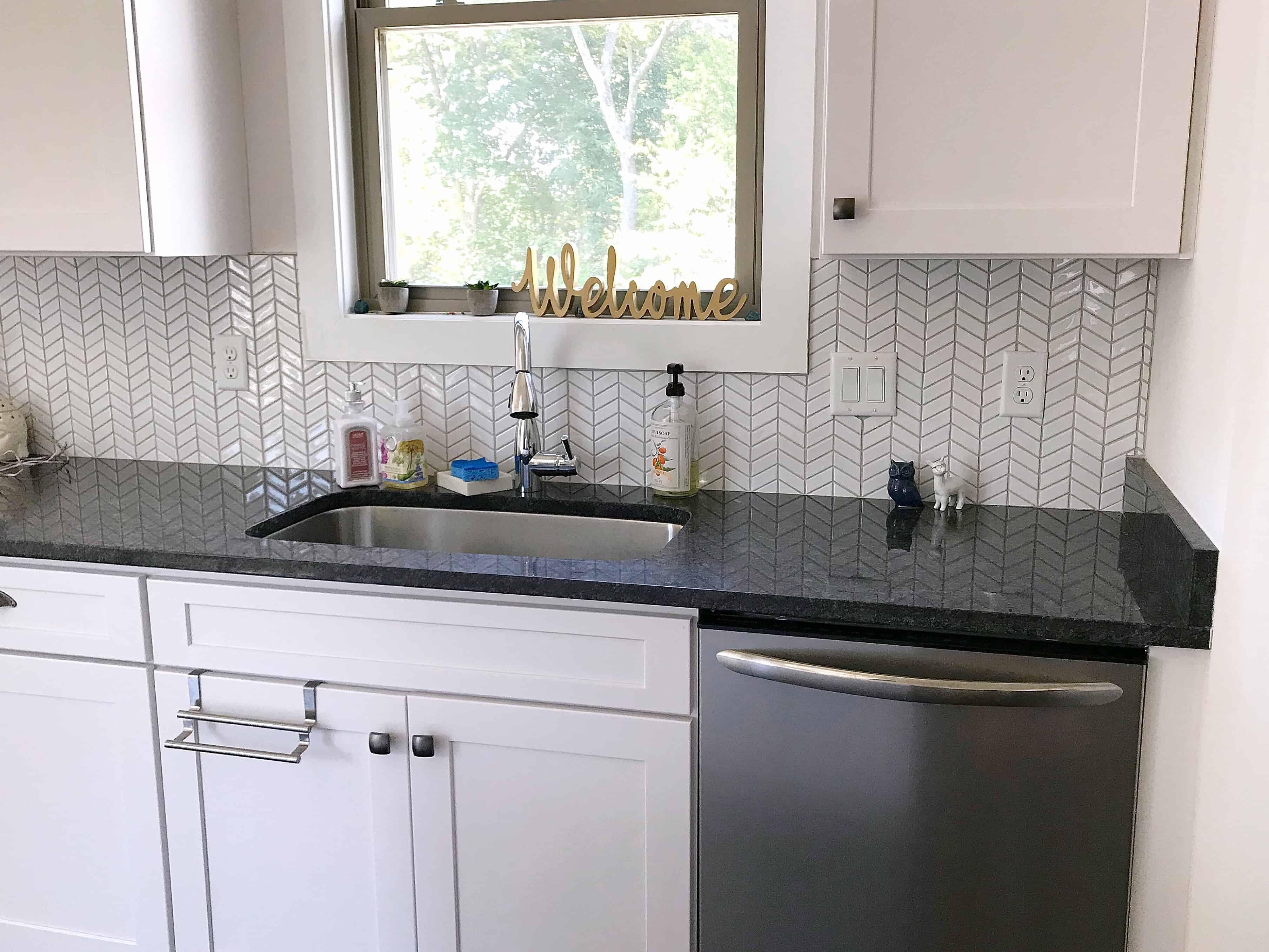 Grey and white kitchen with granite worktops
