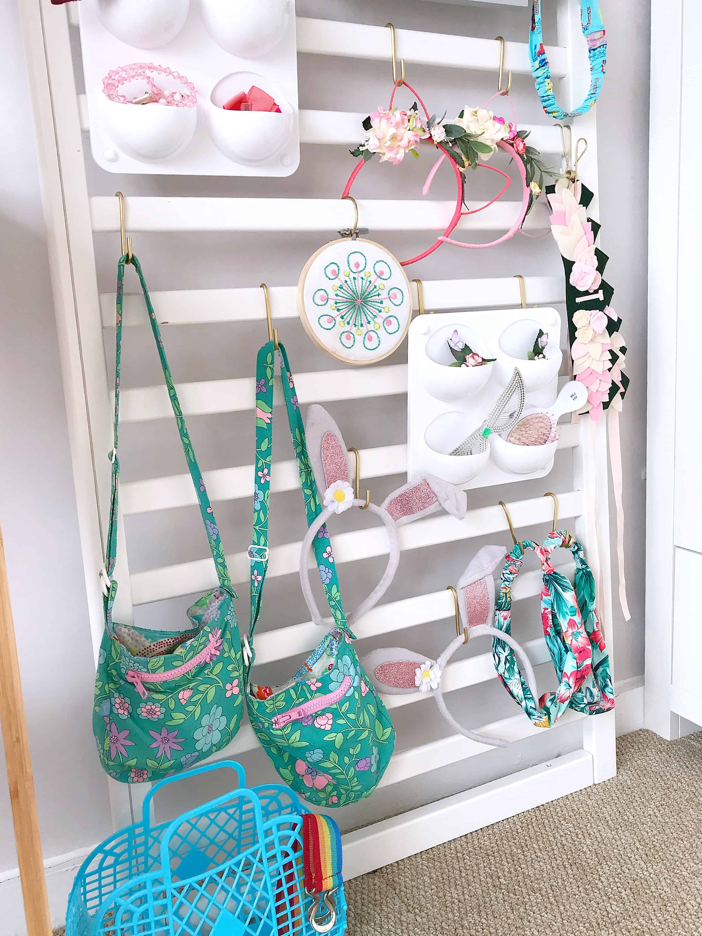 White accessories organiser made from an old cot side and IKEA s hooks
