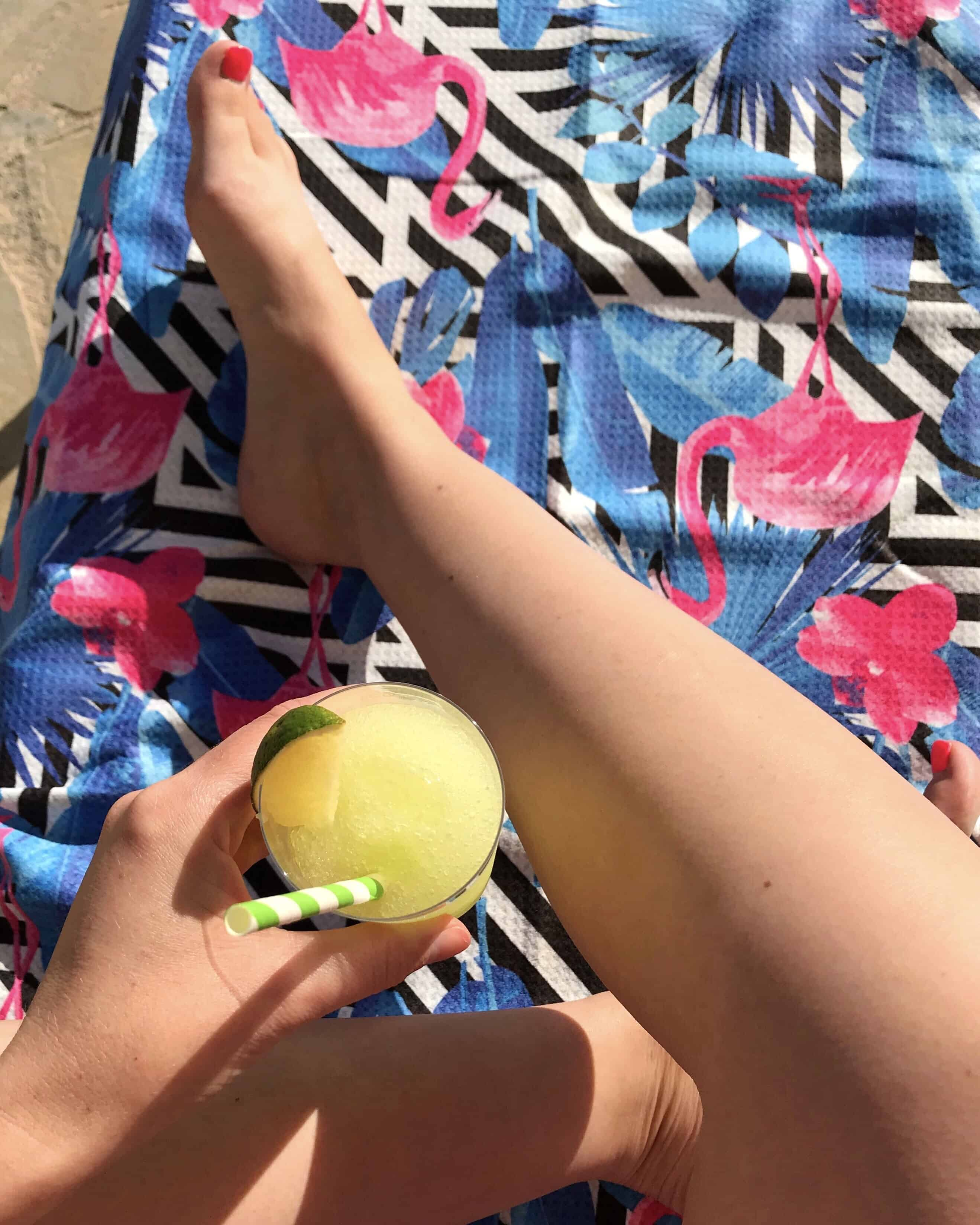 Cocktail on a sun lounger with flamingo design Tesalate beach towel