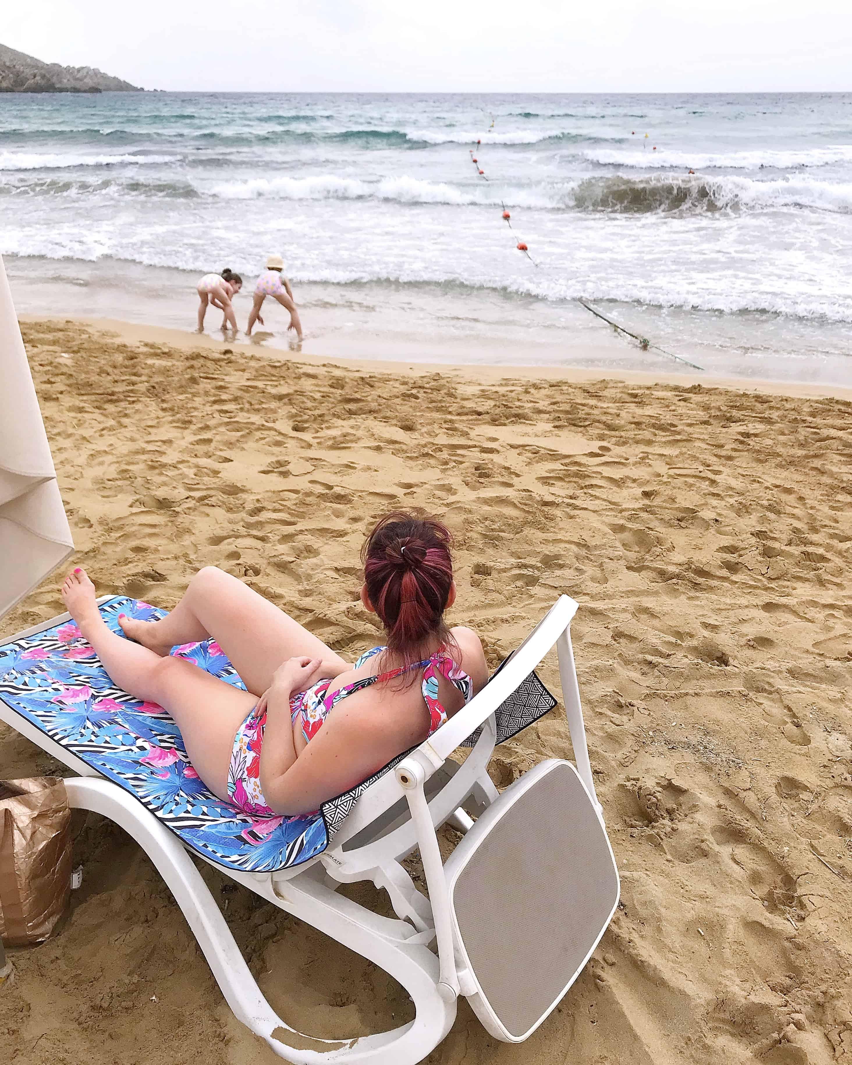 Relaxing on Golden Sands beach in Malta