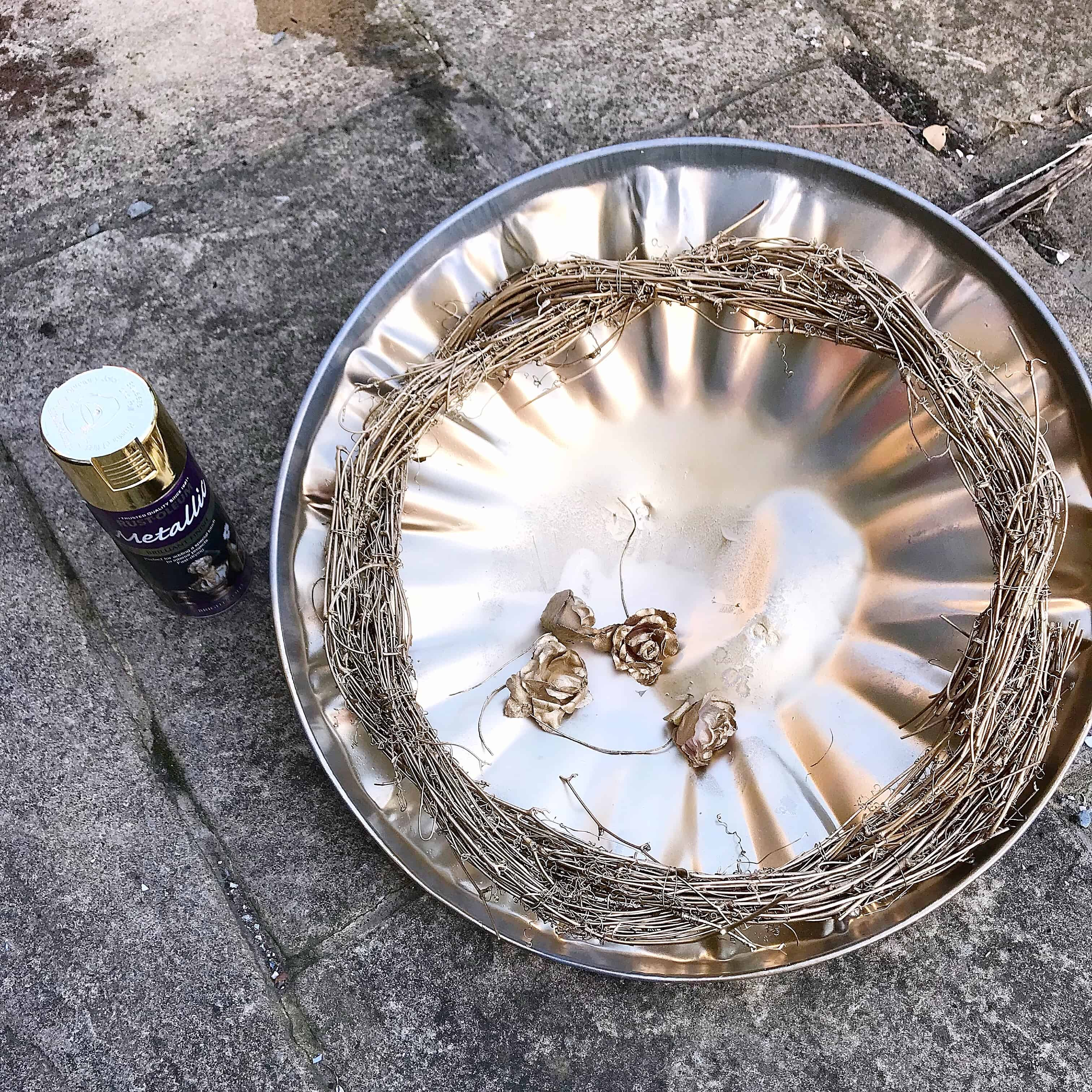 Step 1 to make an easy metallic wreath - spray it gold