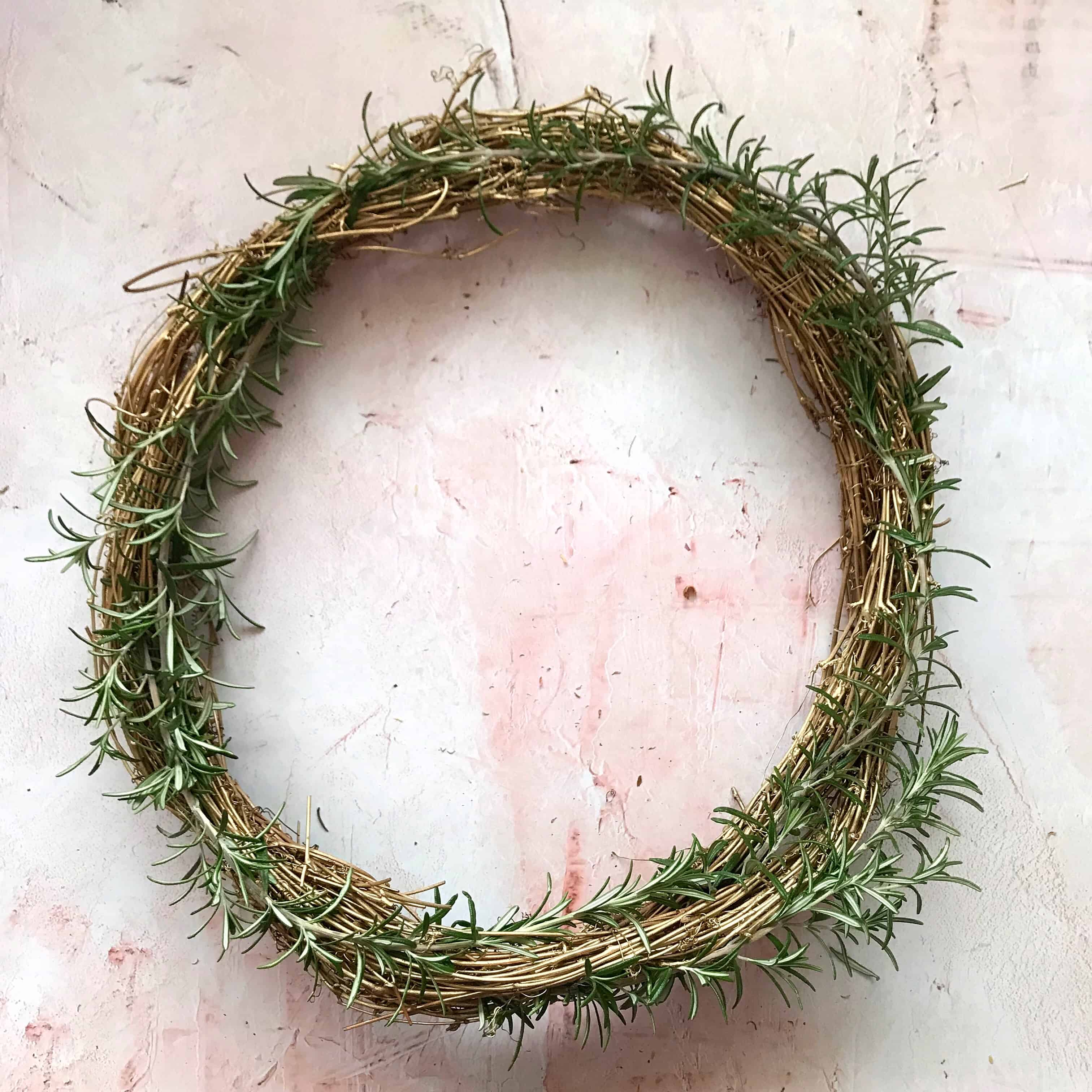 Step 3 to make an easy metallic wreath - attach greenery