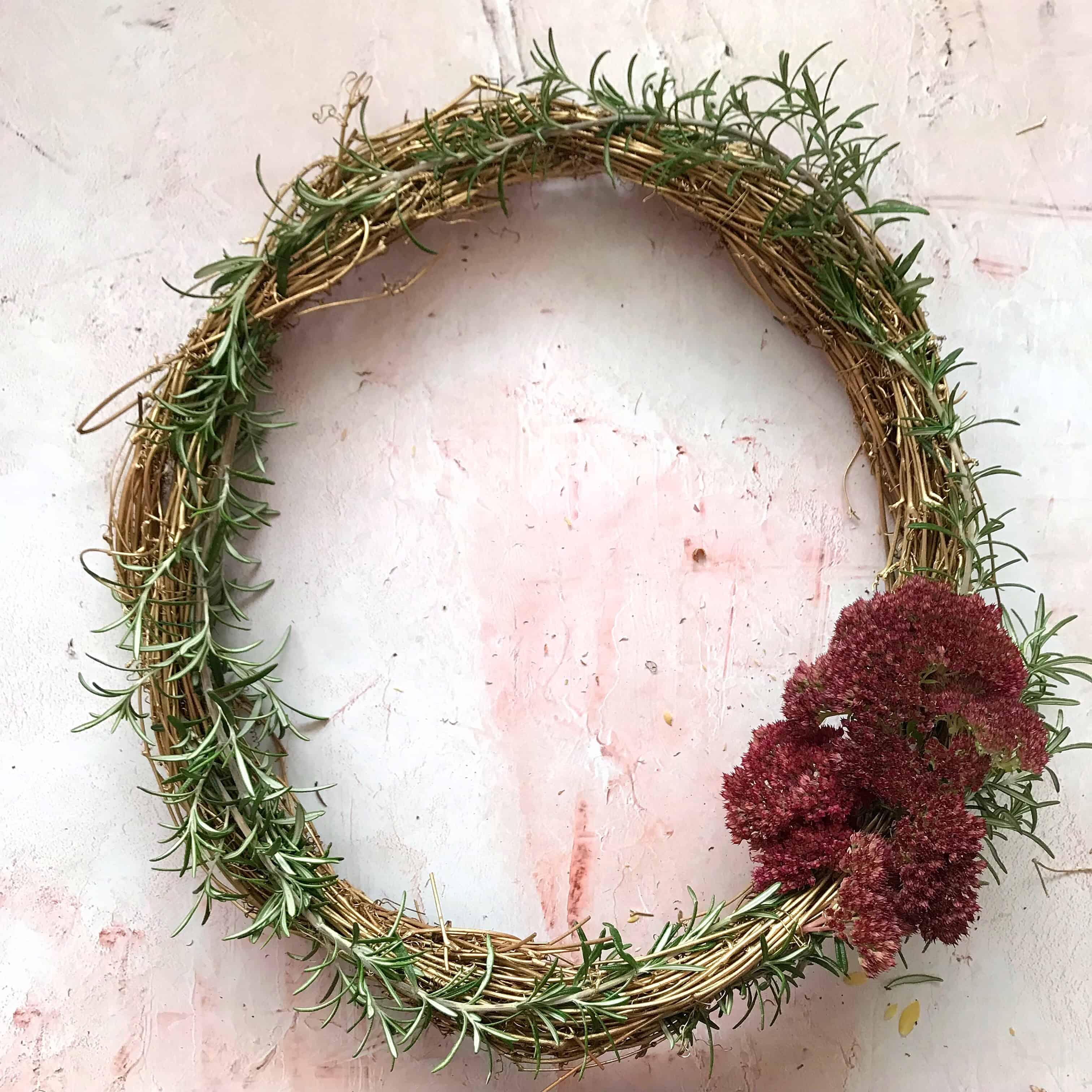 Step 4 to make an easy metallic wreath - attach flowers