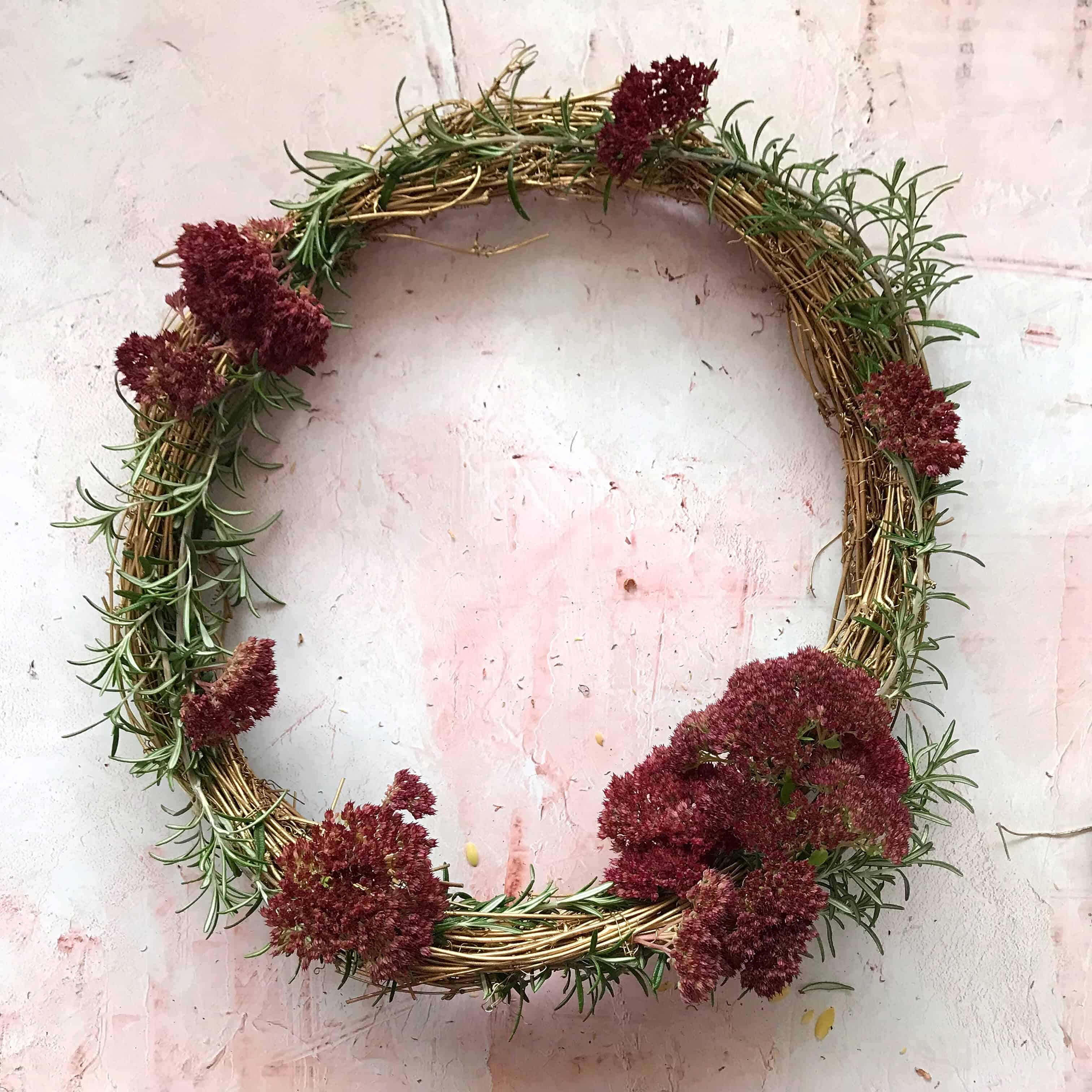 Step 4 to make an easy metallic wreath - build layers of flowers