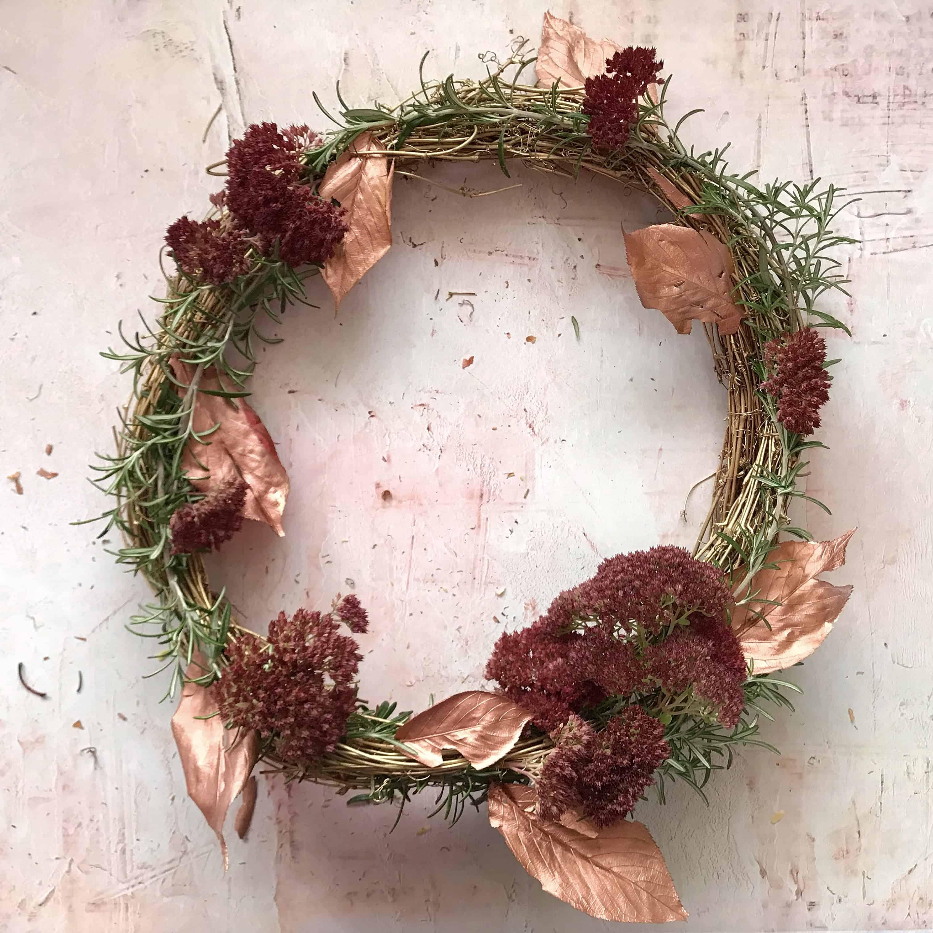 Metallic Door Wreath Tutorial Step 5 - slot in leaves