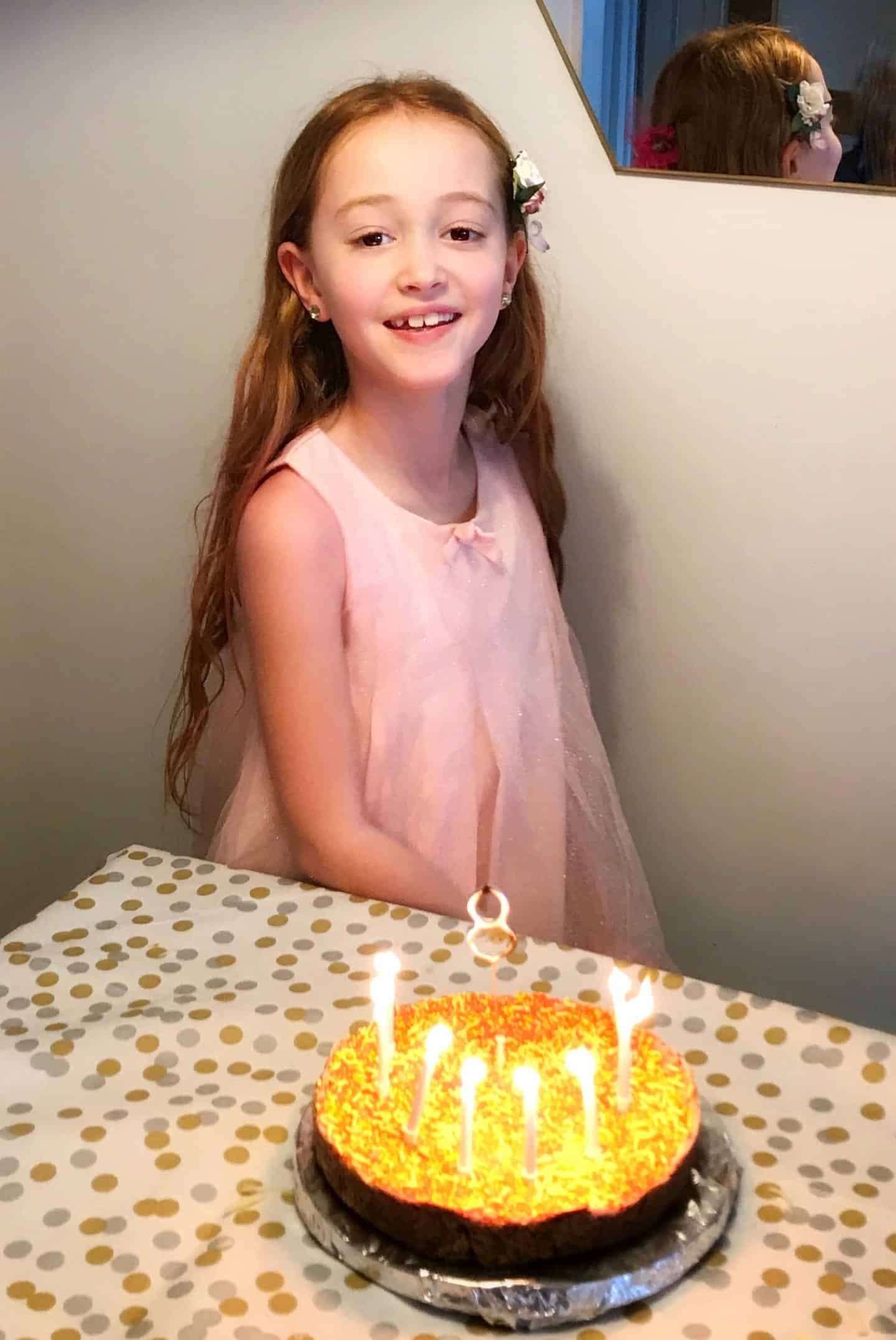 Birthday girl with her neon pink cake