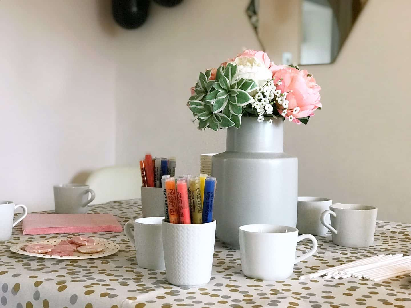 Ceramic mugs and paint markers ready to decorate