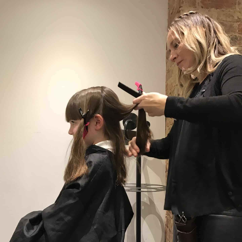 Thea getting her hair cut