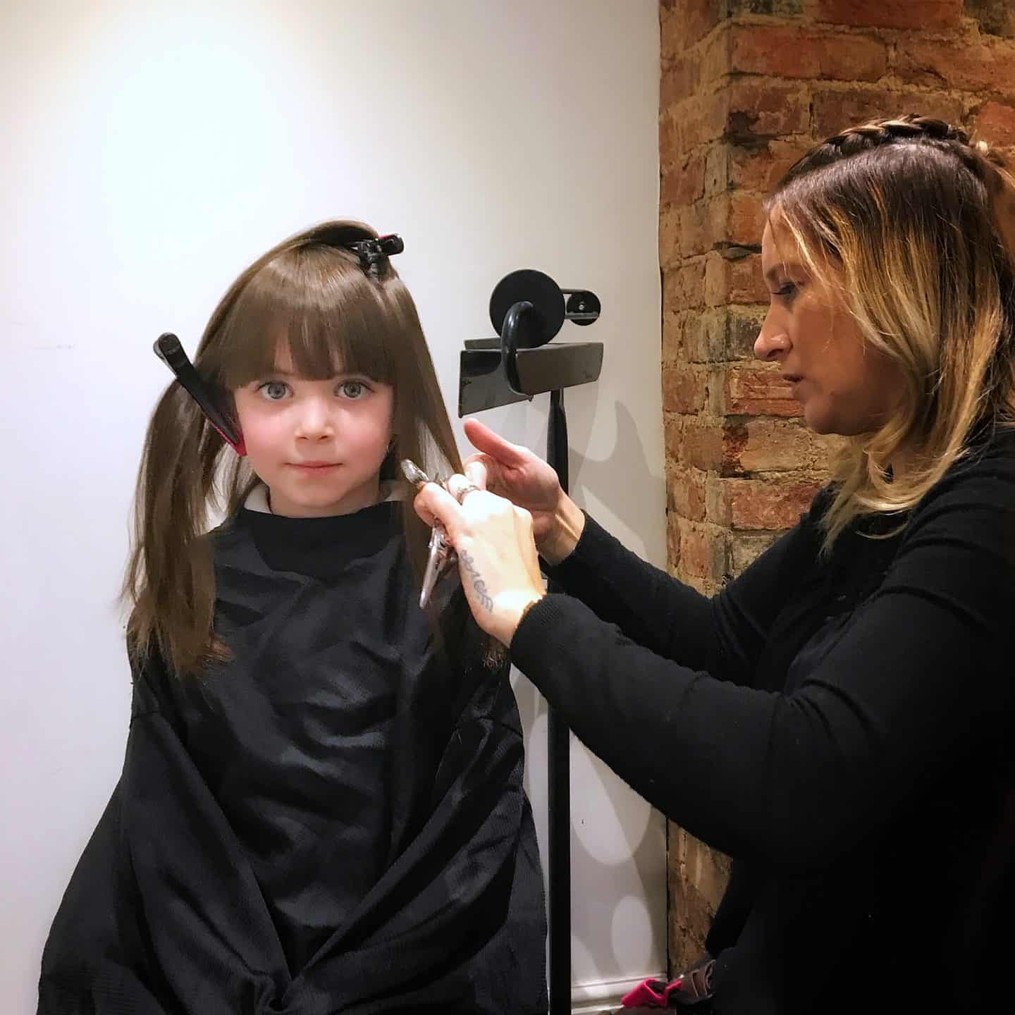 Thea with her new fringe getting her hair cut