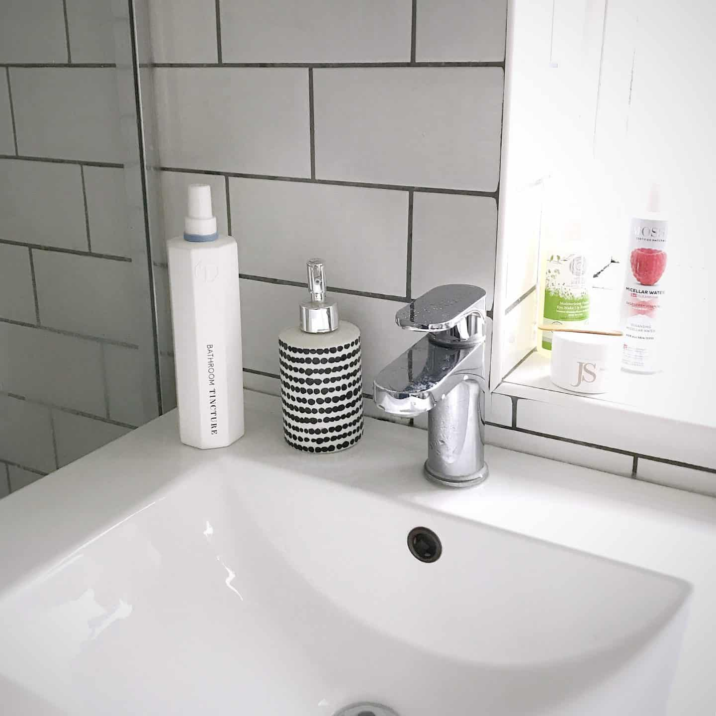 Tincture London eco-friendly cleaning spray for bathrooms in a monochrome bathroom