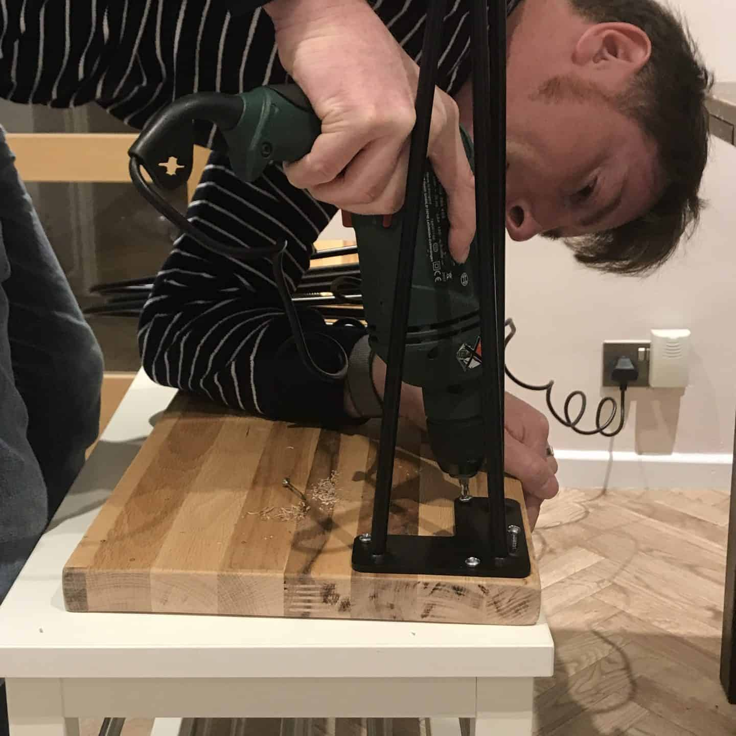 Drilling in the screws to a stool