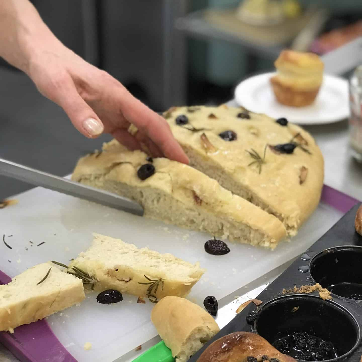 Freshly baked foccacia being sliced