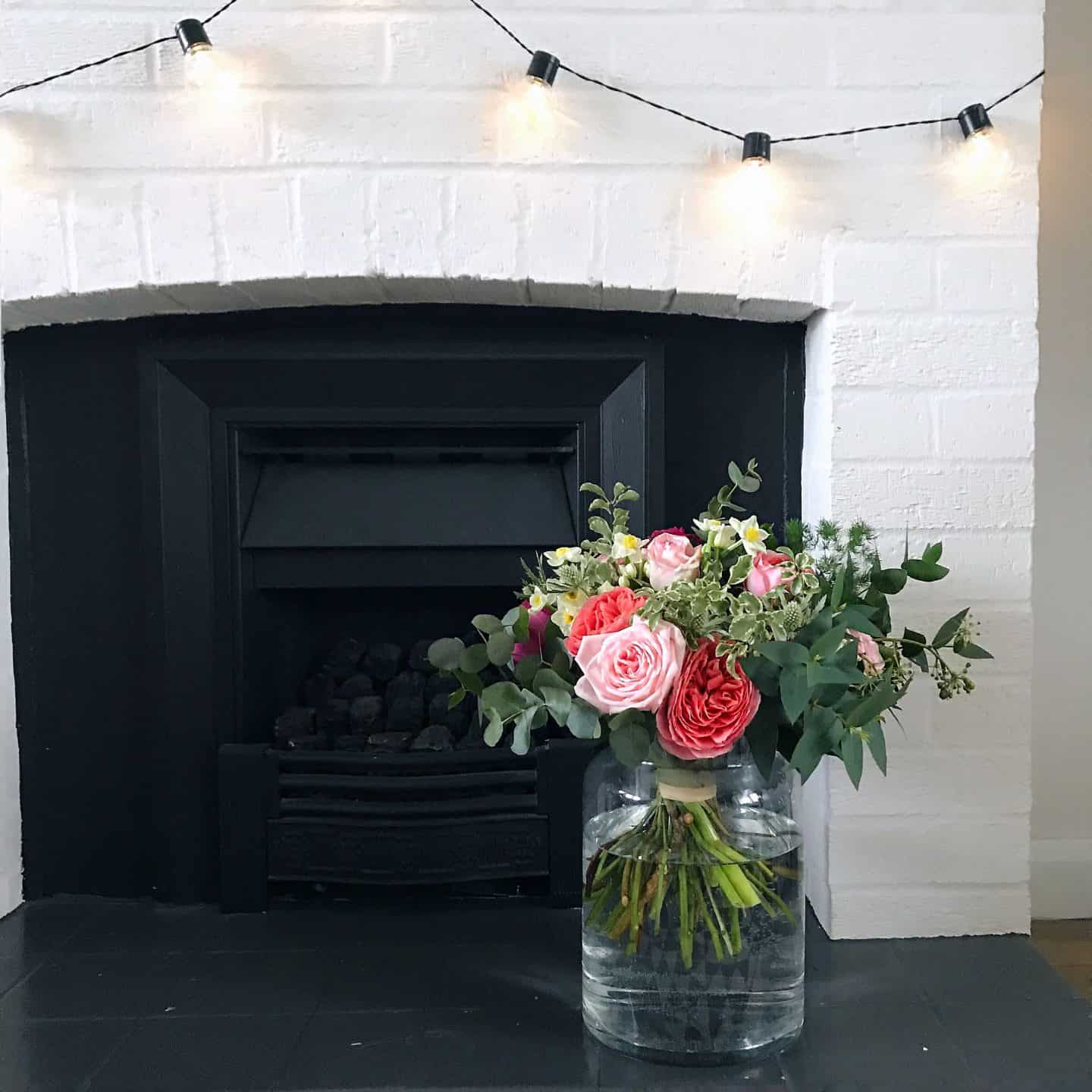 A beautiful bouquet of sustainable Mother's Day flowers from The Real Flower Company in front of a fireplace.