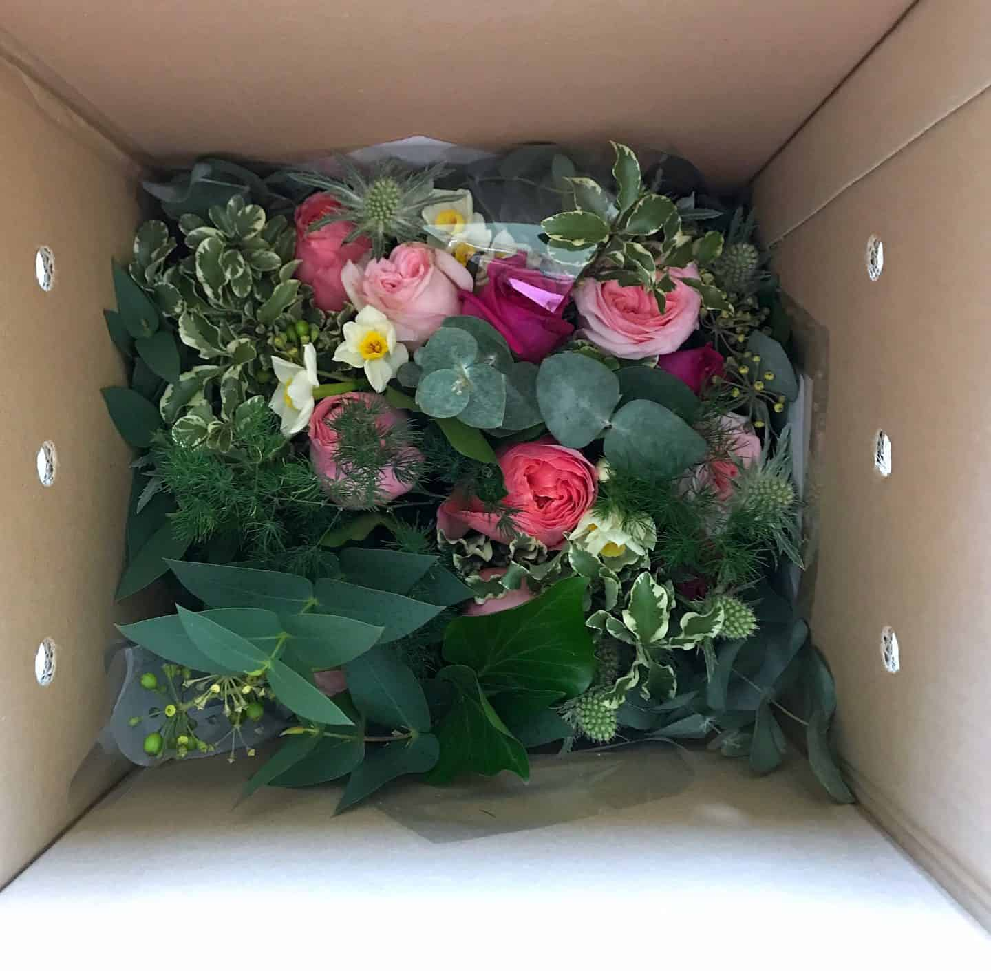 Sustainable flowers in their delivery box from The Real Flower Company