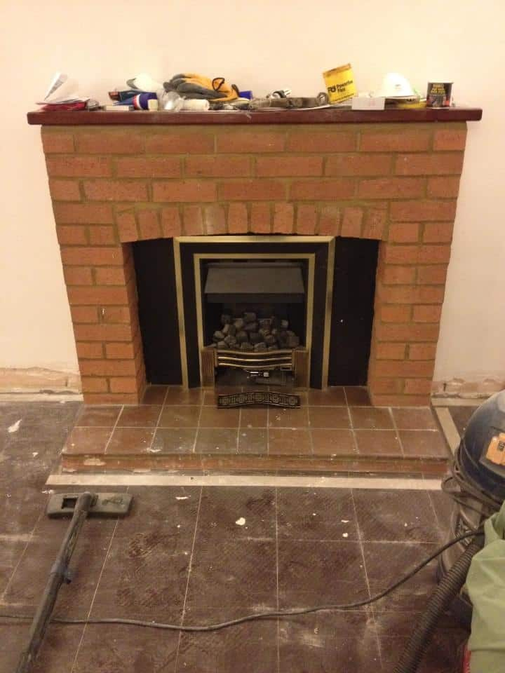 Our old ugly fireplace before we painted it