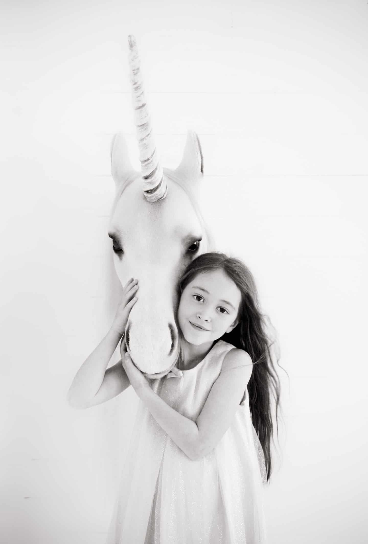 Ava and a unicorn photographed by Shaneen Rosewarne Cox