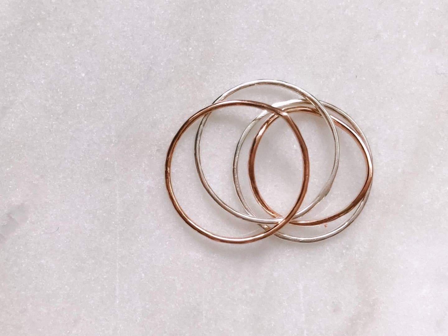 Nikki Stark Jewellery recycled silver and rose gold skinny rings