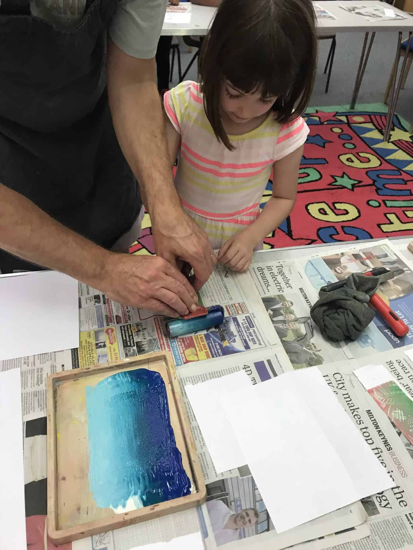 Applying ink to her polystyrene design