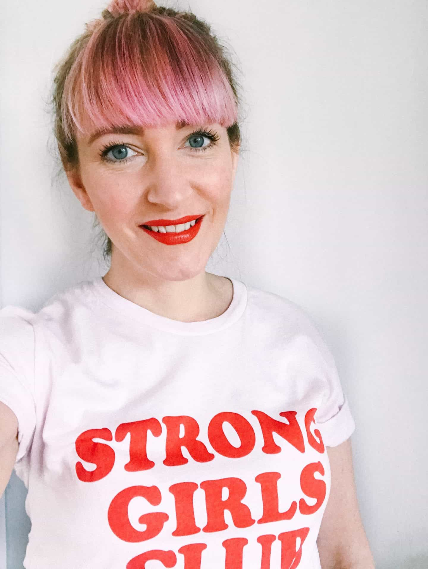 Becky Pink wearing a organic, ethical Strong Girls Club empowerment T-shirt from Mutha.Hood
