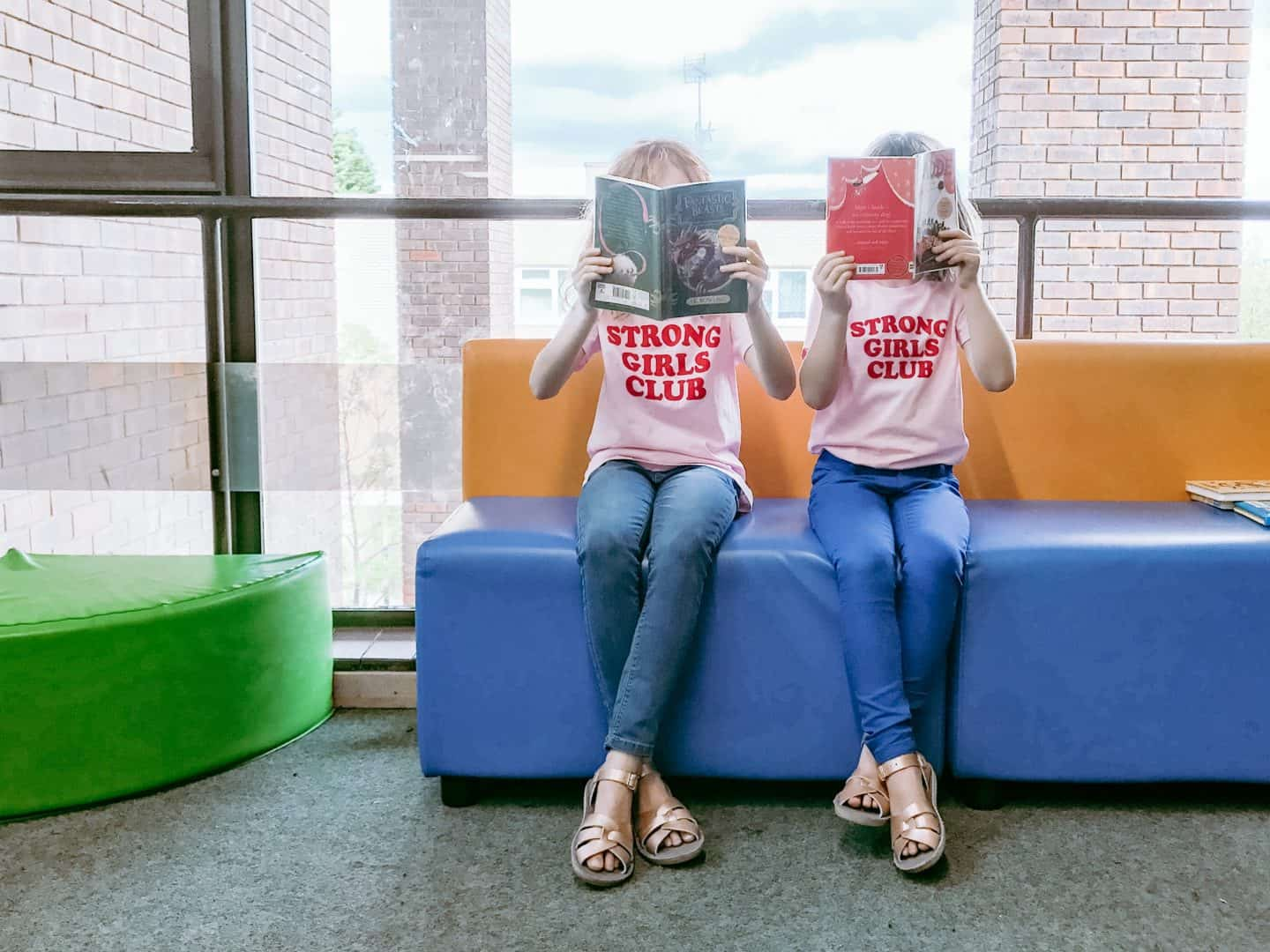 Wearing Strong Girls Club ethical t-shirts in a library