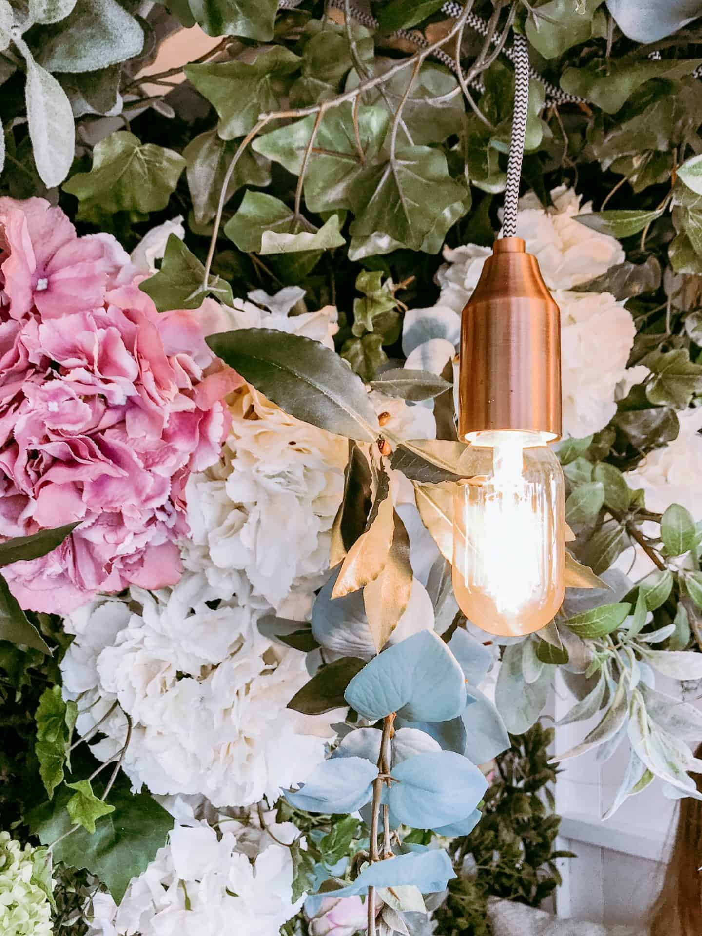 Copper lamp and flowers in the Garden Den