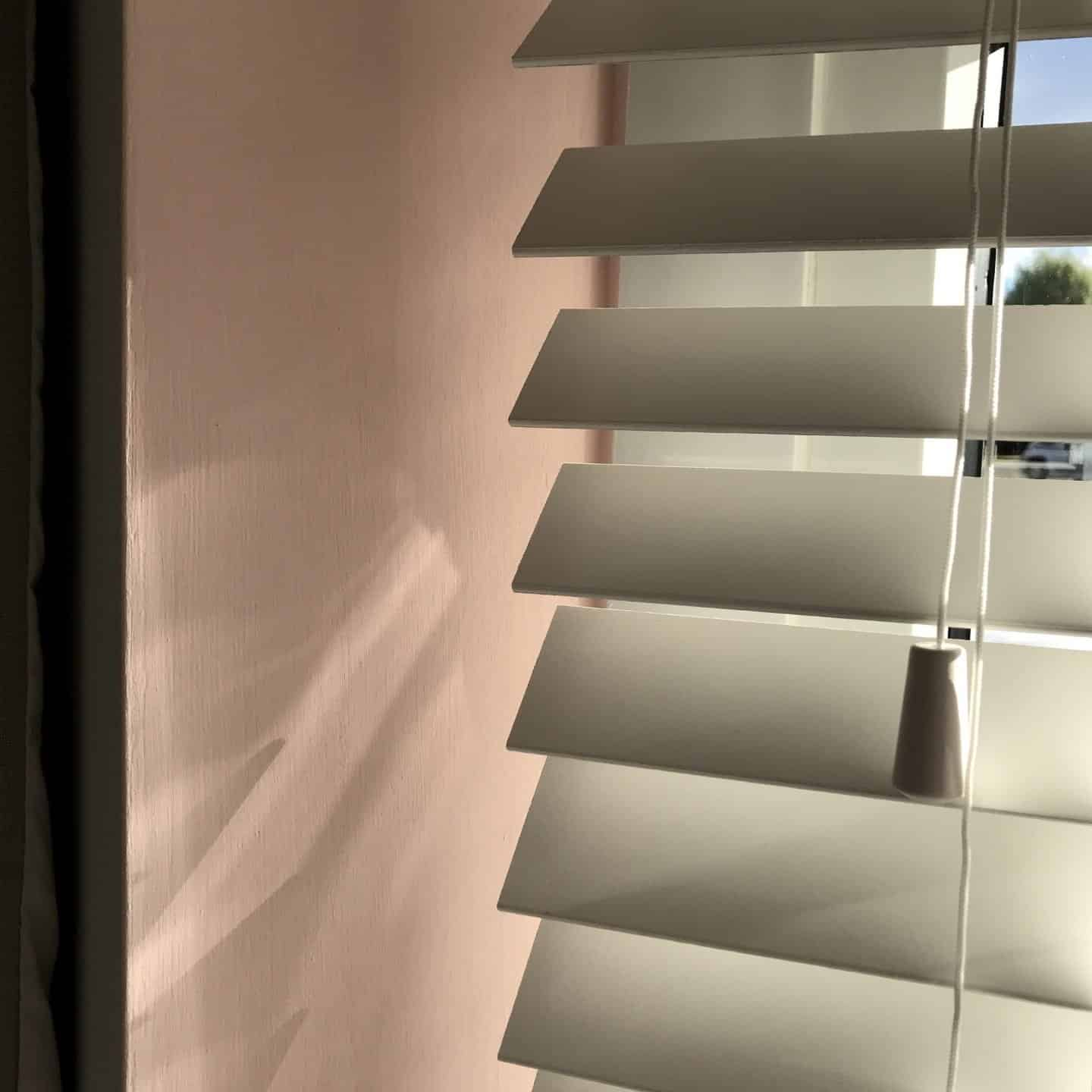 50mm white wooden blinds close up