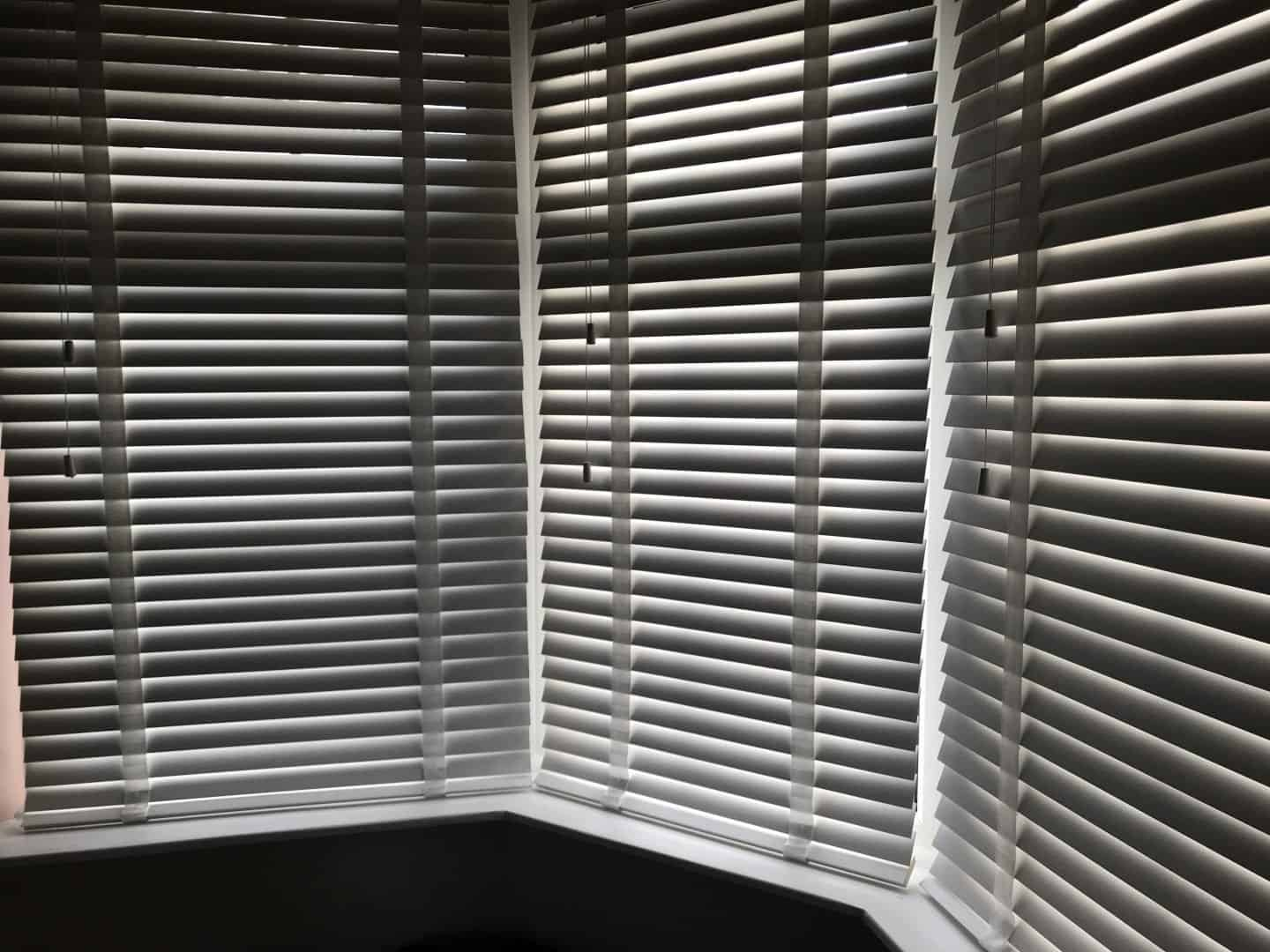 Bay window with white wooden blinds from Make My Blinds