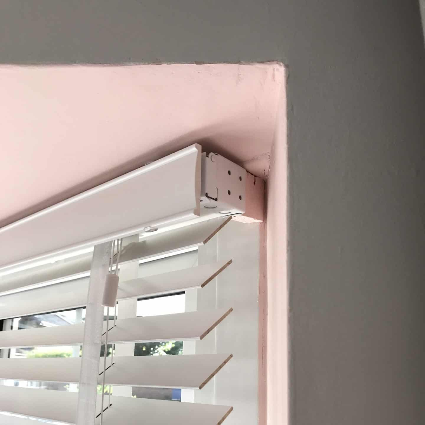Ends of white wooden blinds
