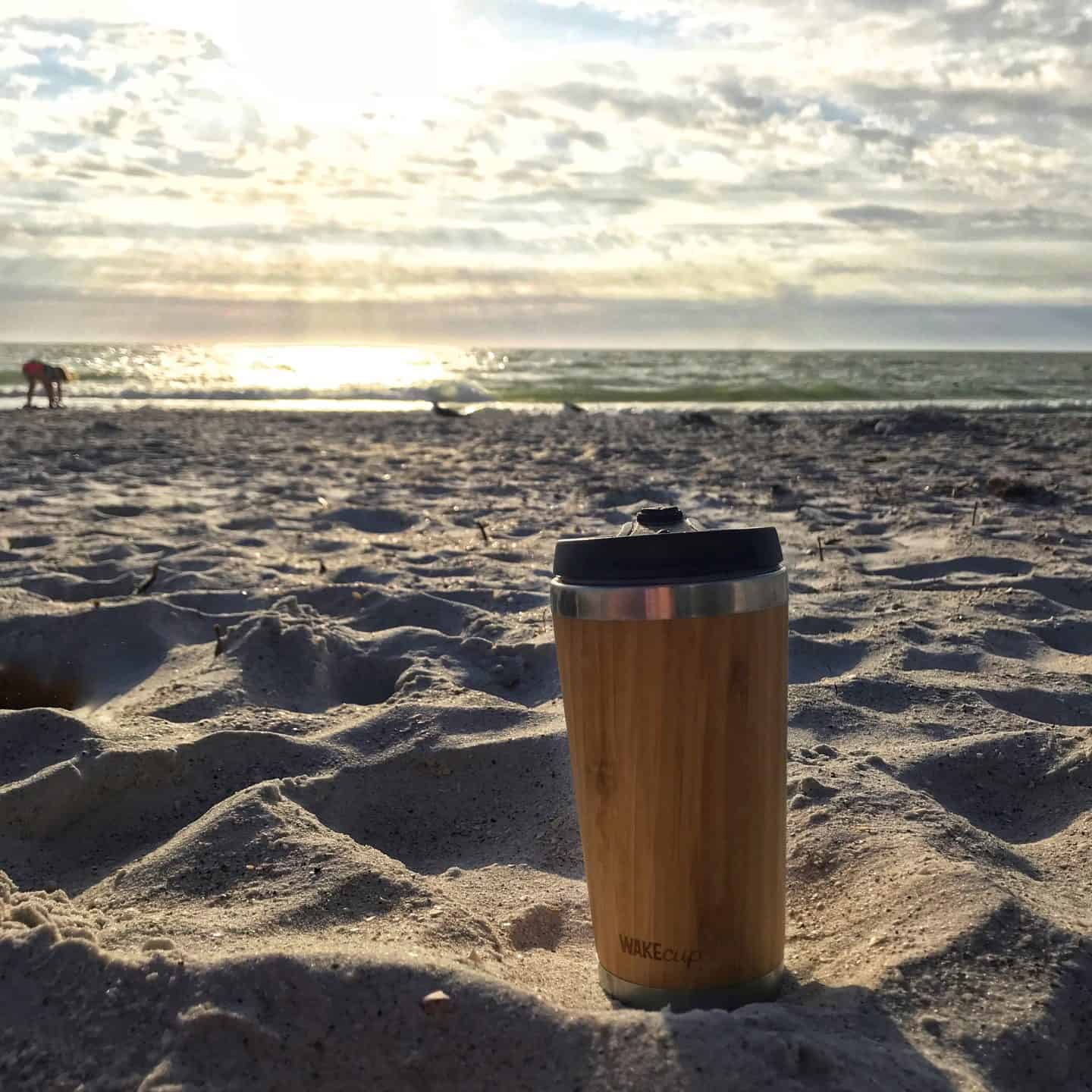 Global WakeCup reusable cup on a beach