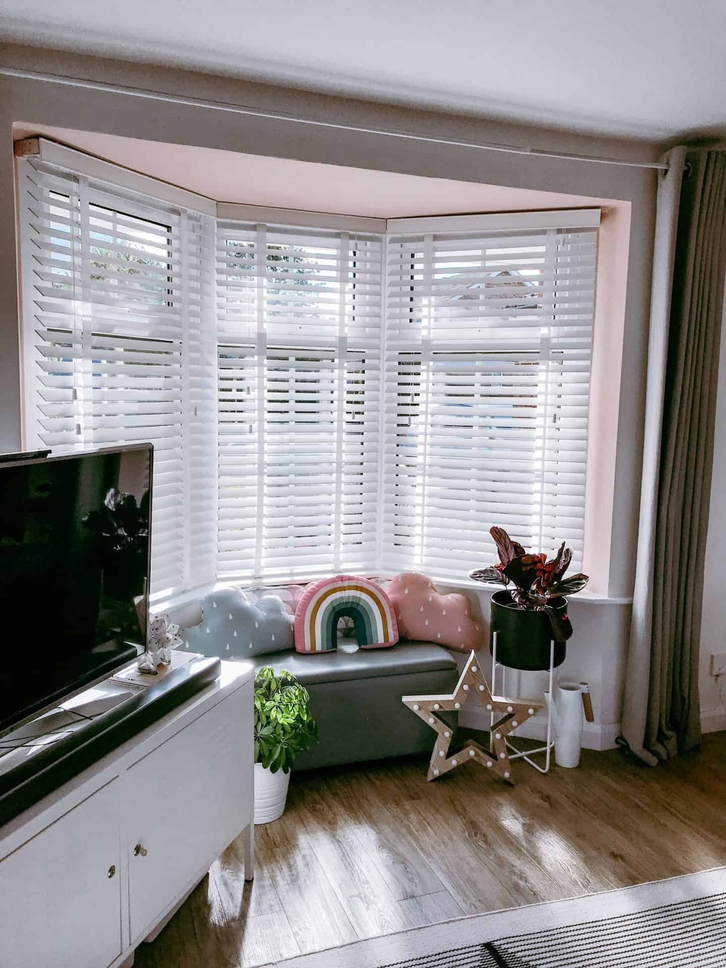 White 50mm wood blinds with tapes give a shutter like effect