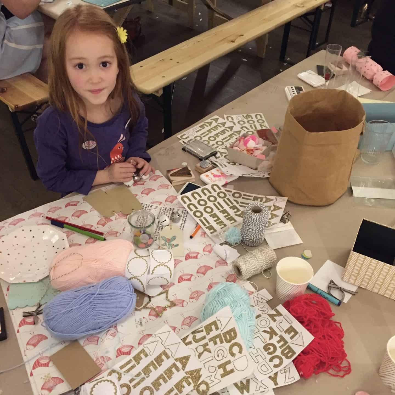 A girl making home made Christmas present tags